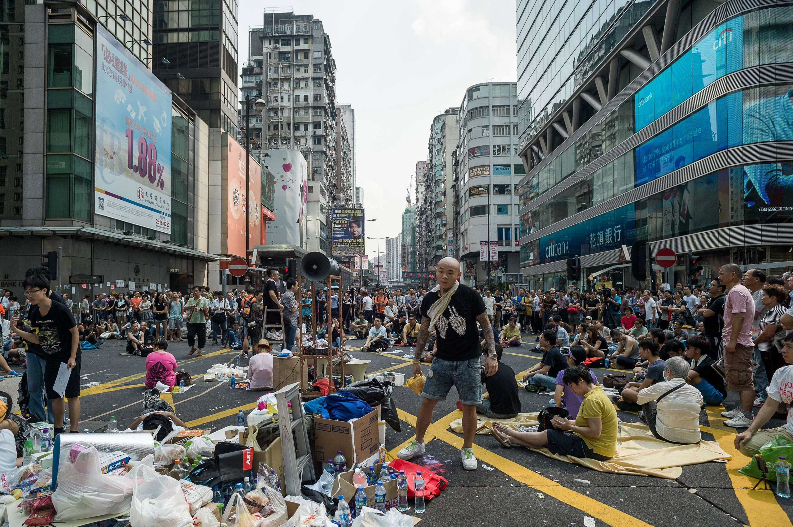 Pro-democracy demonstrators rest during a protest in Hong Kong on Sept. 30, 2014.