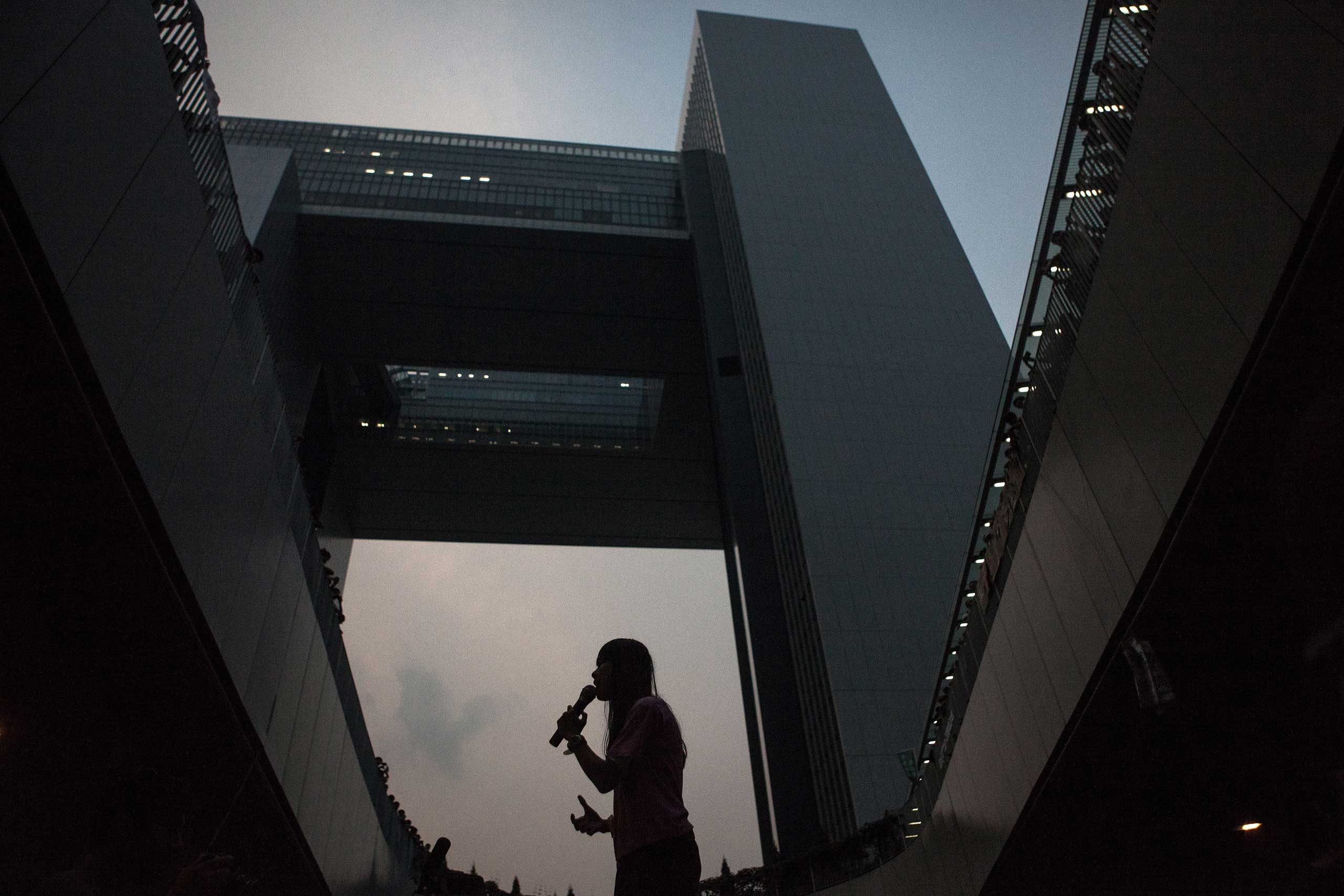 A pro-democracy protestor speaks to the crowd in front of the government offices in Hong Kong on Sept. 30, 2014.