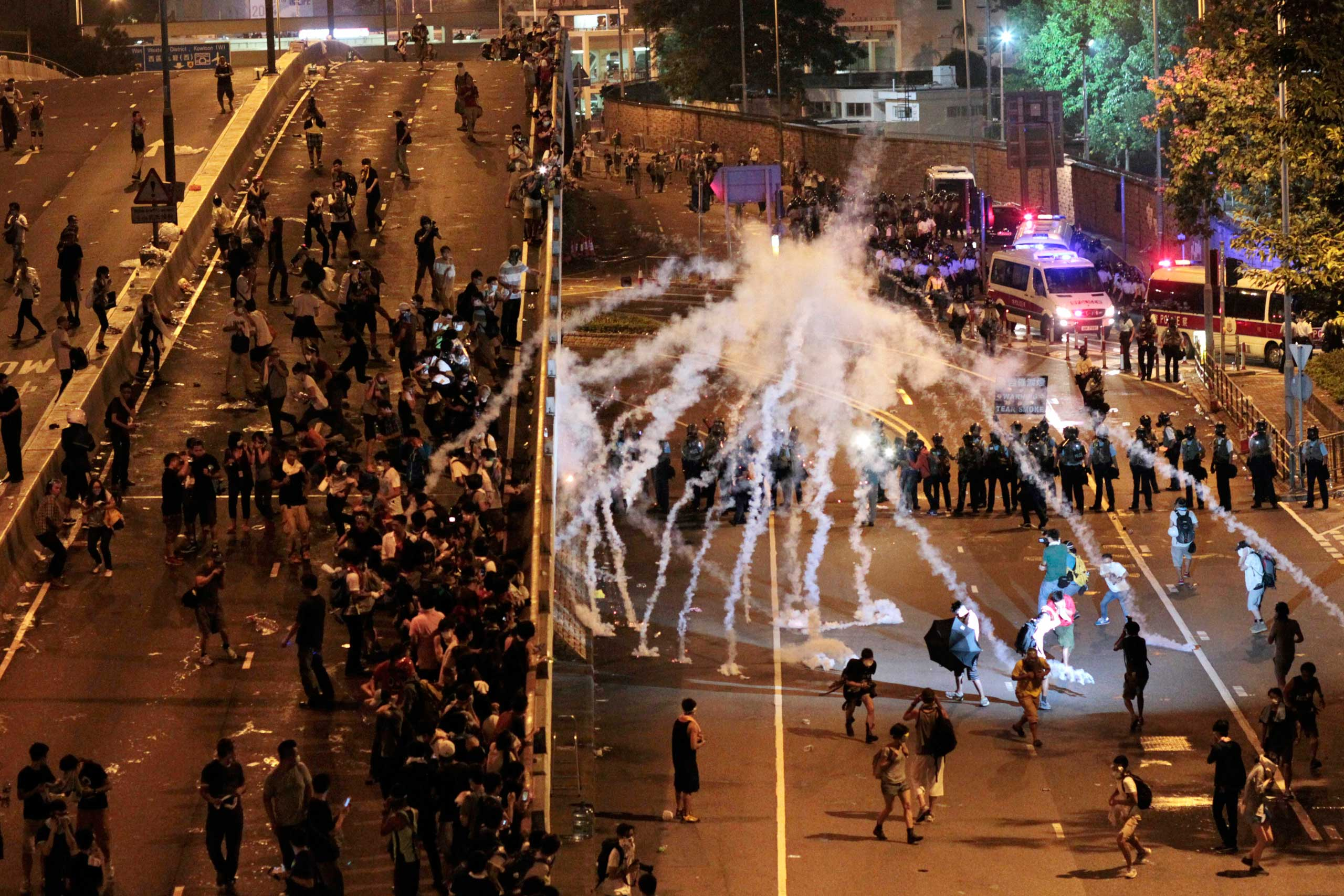 Riot police fire tear gas on student protesters occupying streets surrounding the government headquarters in Hong Kong, early on Sept. 29, 2014.