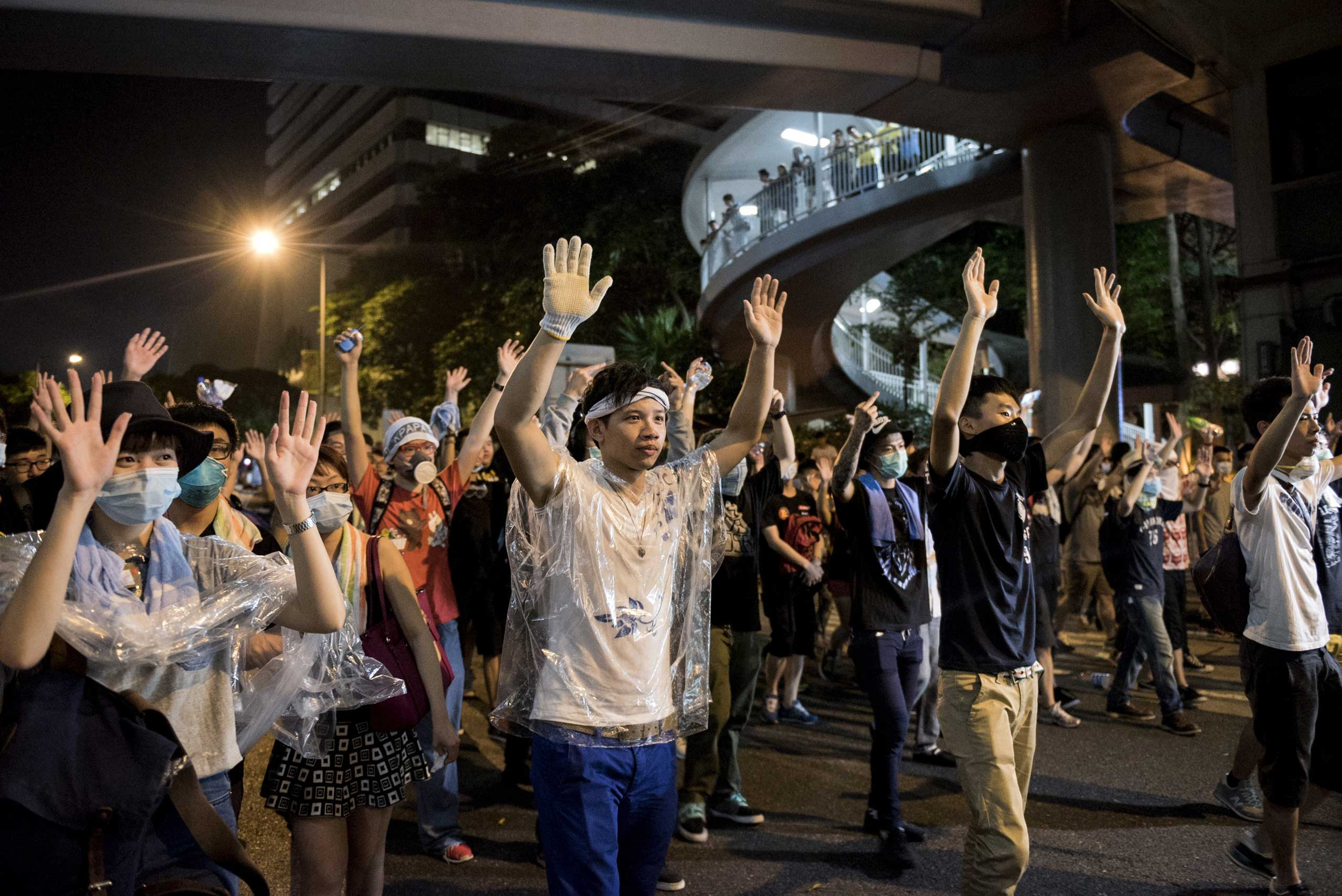 Pro-democracy protesters put their hands up in the air in front of the police in Hong Kong on Sept. 28, 2014