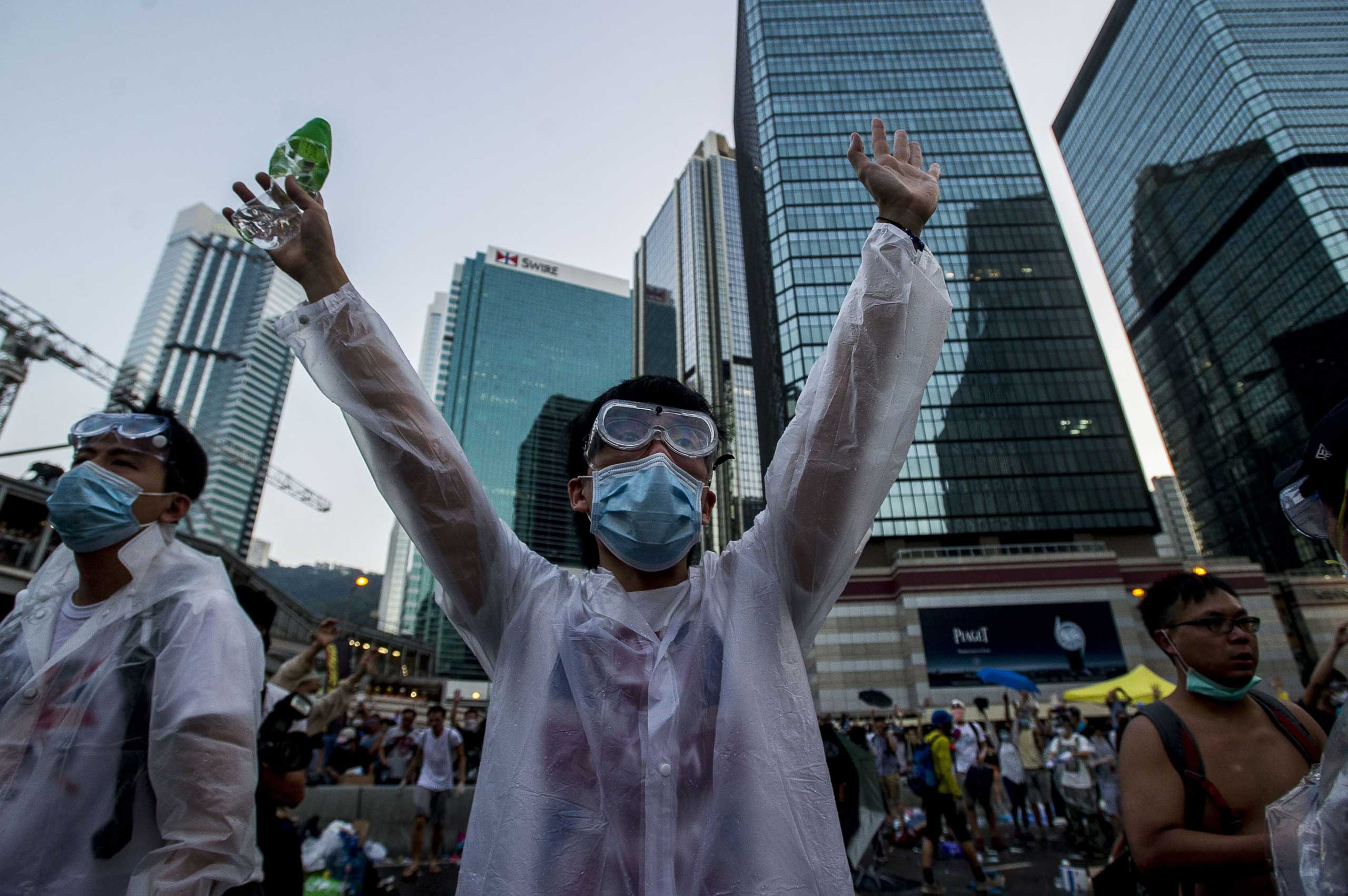 A pro-democracy demonstrator wearing a mask and goggles to protect against pepper spray and tear gas gestures during a rally near the Hong Kong government headquarters on Sept. 28, 2014.