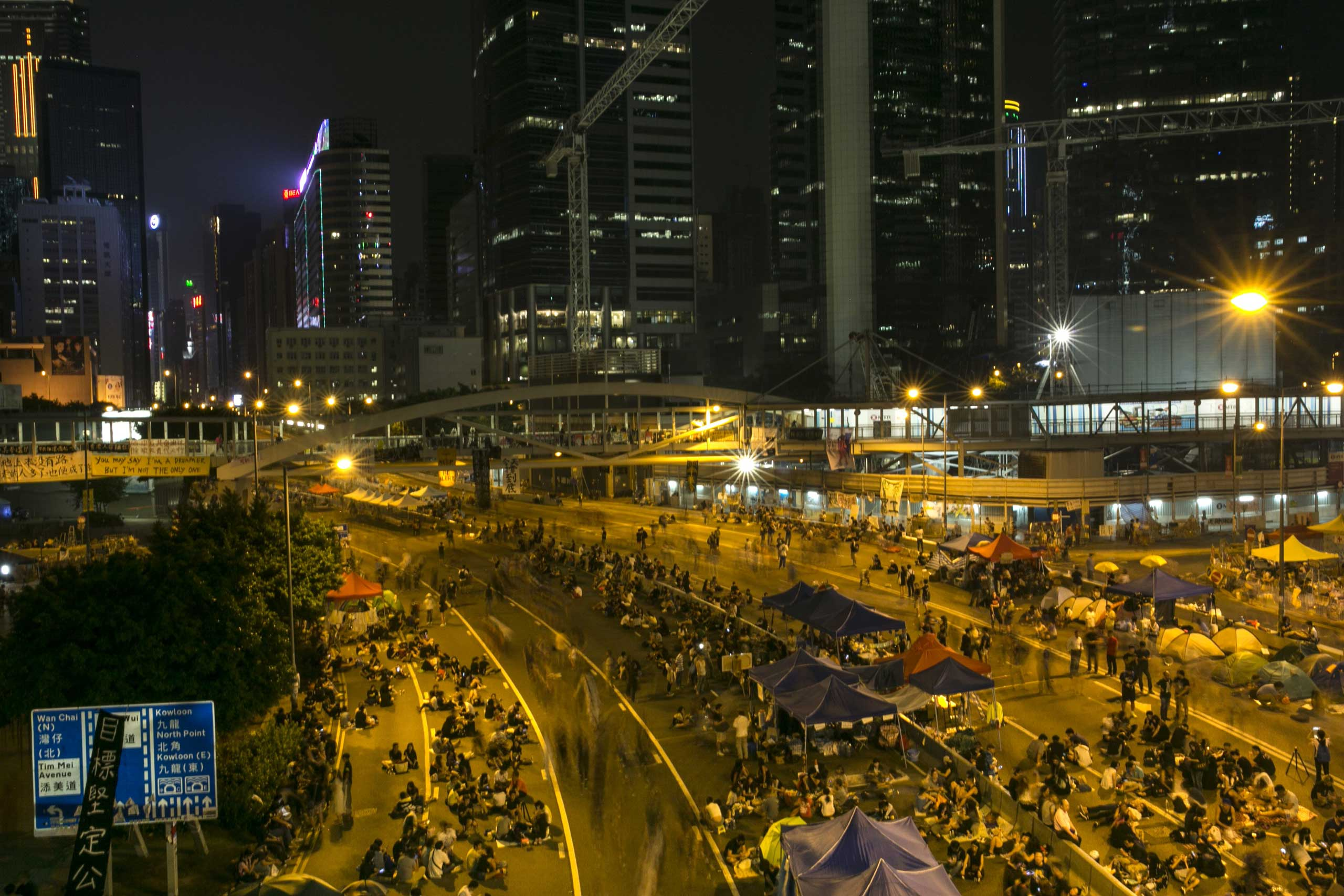 Protesters walk along the protest site on a quiet night as the standoff continues Oct. 5, 2014 in Hong Kong.