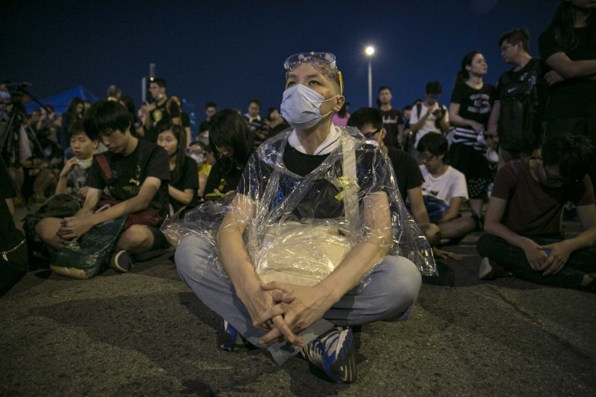 Protesters sit behind a government building as the standoff continues Oct. 5, 2014 in Hong Kong.