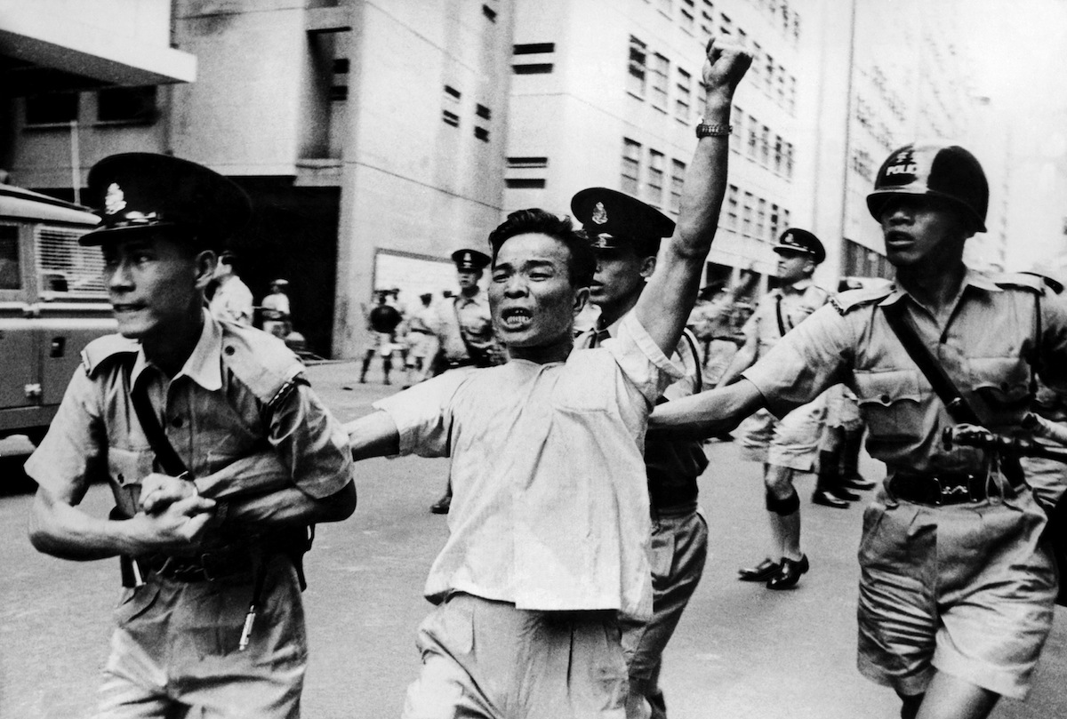 A pro-China protester arrested by police officers during a demonstration in Hong Kong on May 18, 1967.