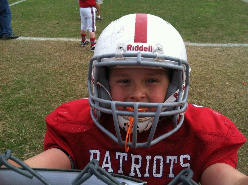 The author's 9-year-old son in his football gear