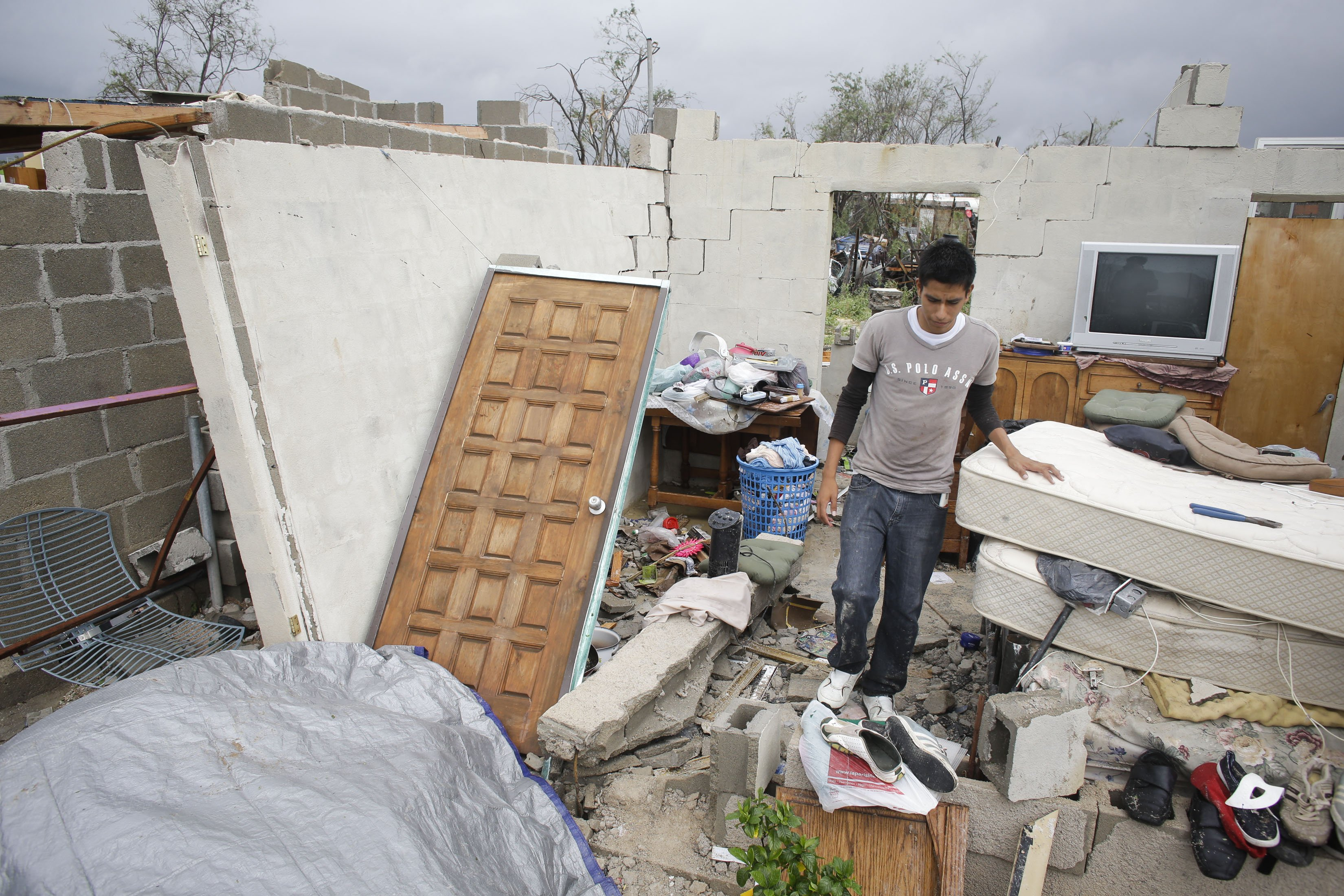 Raimundo Diaz, 17, walks inside what used to be a bedroom after his family's house was destroyed by Hurricane Odile in Los Cabos, Mexico, Sept. 15, 2014.