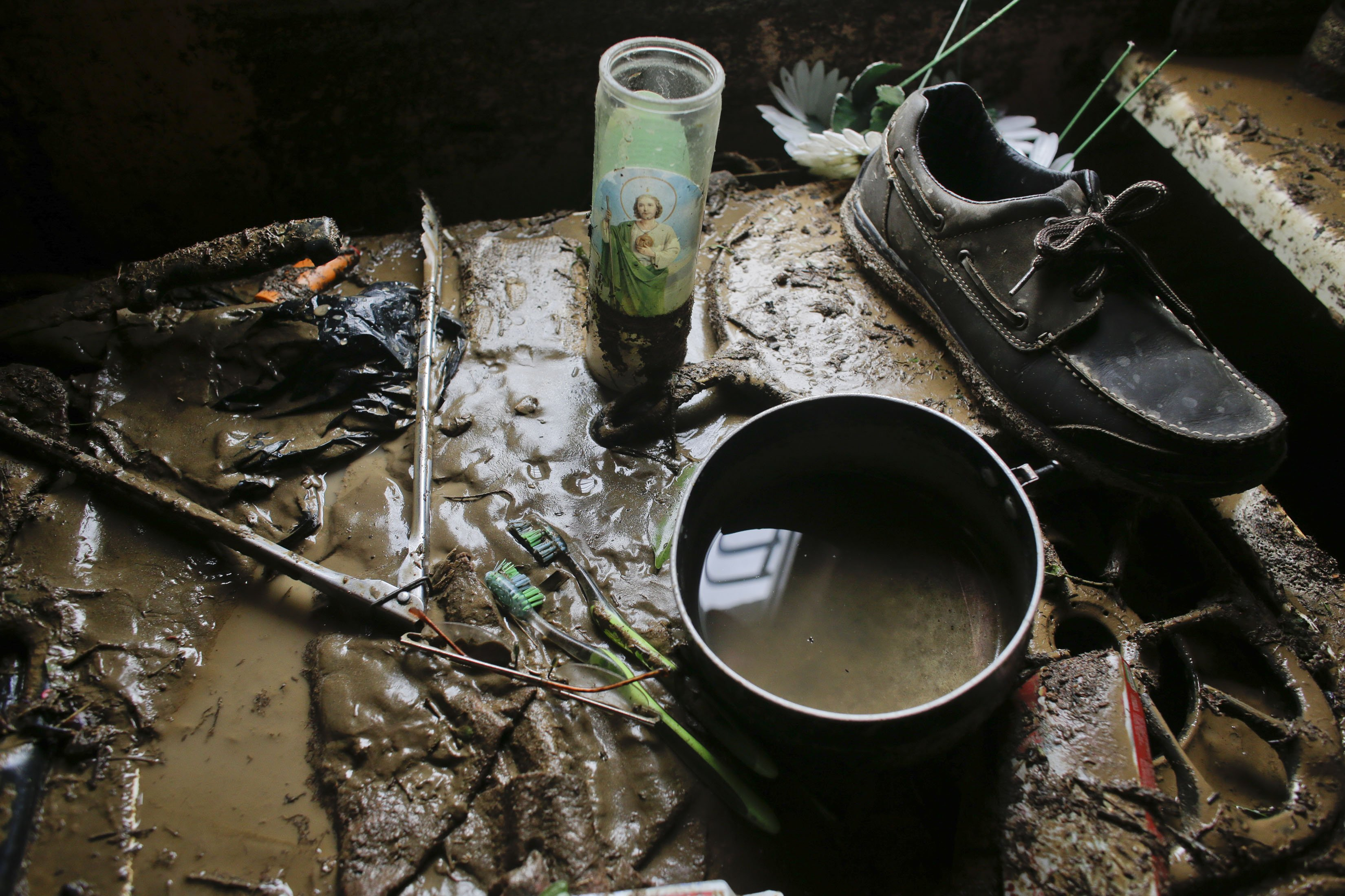 Part of the belongings of Enrique Cota Ceceña sit covered in mud inside his house which was severely flooded by Hurricane Odile in Los Cabos, Mexico, Sept. 15, 2014.
