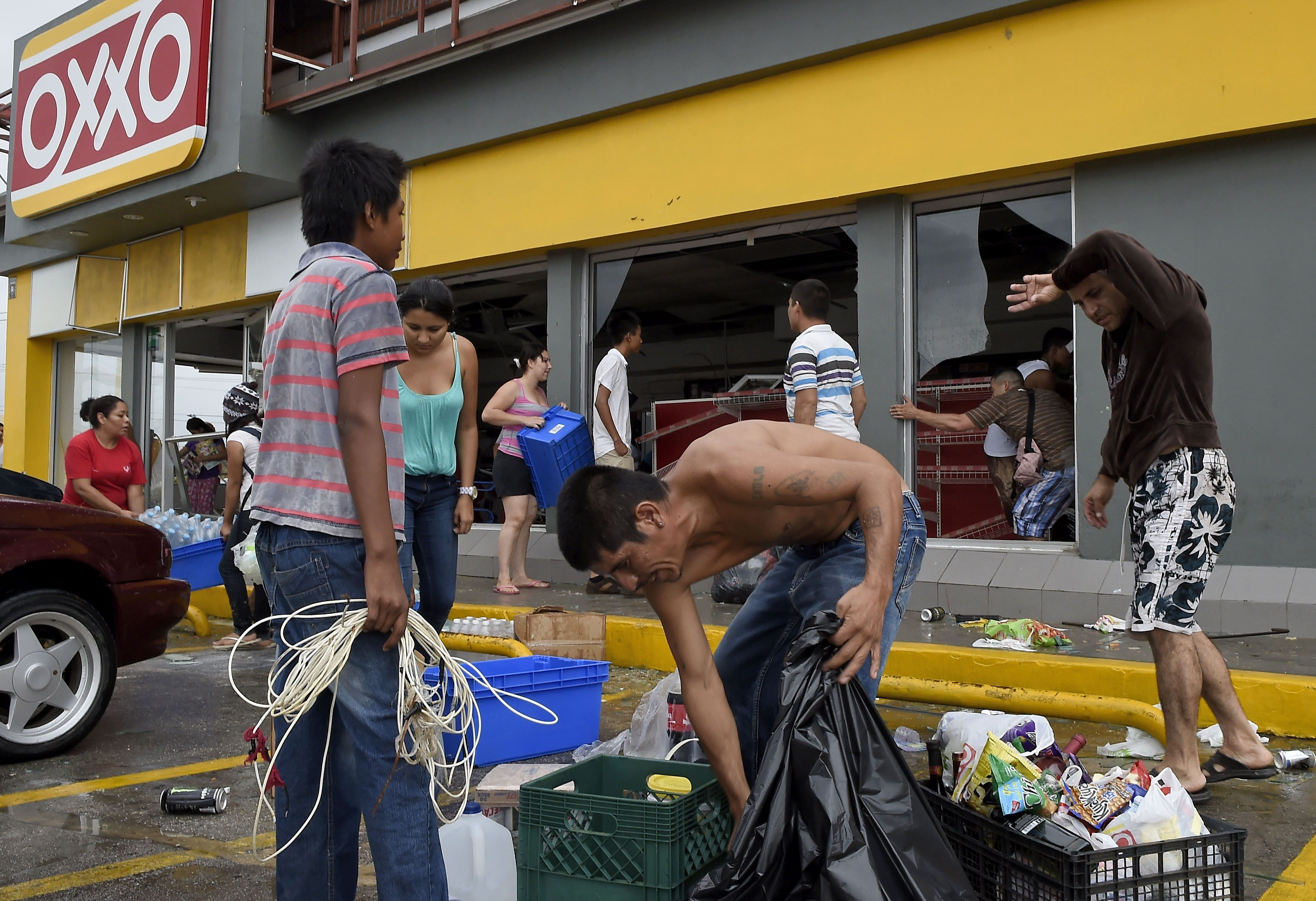 People loot a supermarket after hurricane Odile knocked down trees and power lines in San Jose del Cabo, Mexico on Sept. 15, 2014.