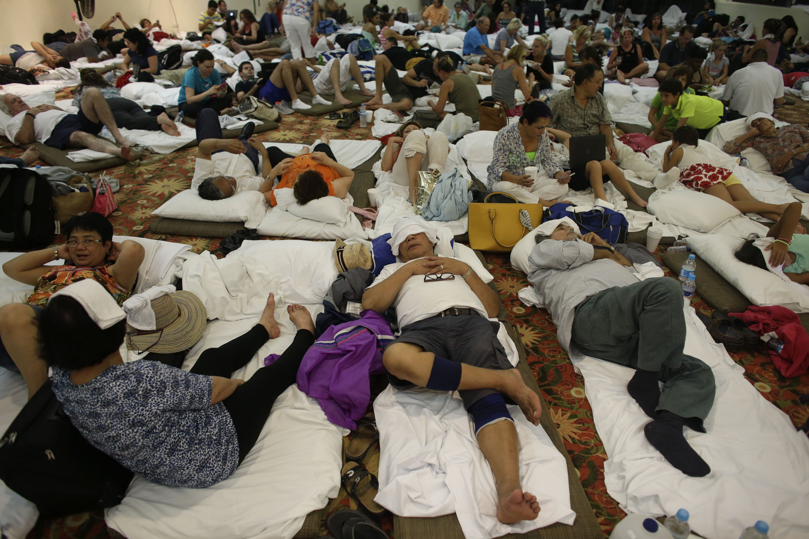 Tourists rest inside a shelter at a resort as Hurricane Odile approaches in Los Cabos, Mexico, Sept. 14, 2014.