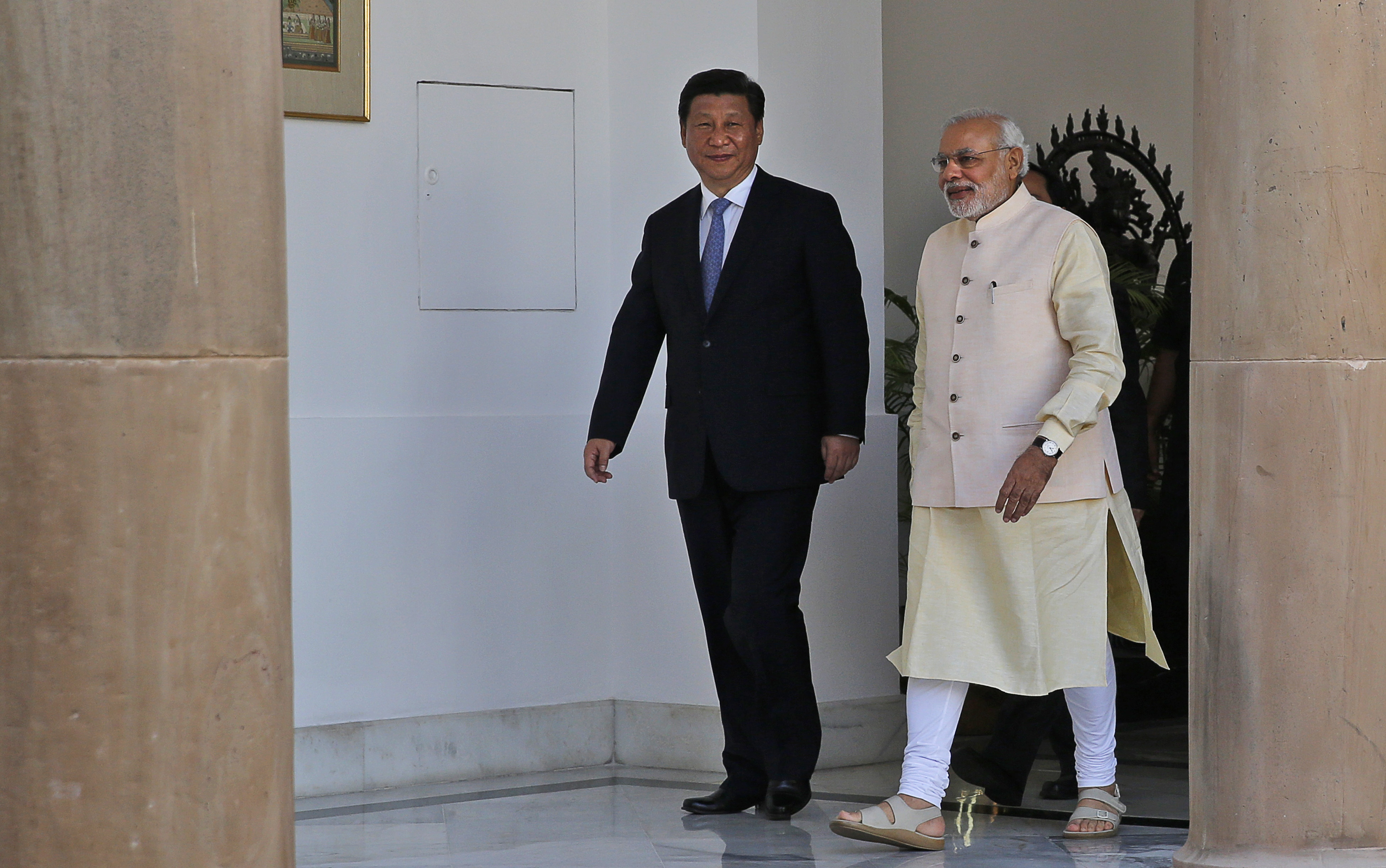 Indian Prime Minister Narendra Modi and visiting Chinese President Xi Jinping walk for a meeting in New Delhi, India, Thursday, Sept. 18, 2014.