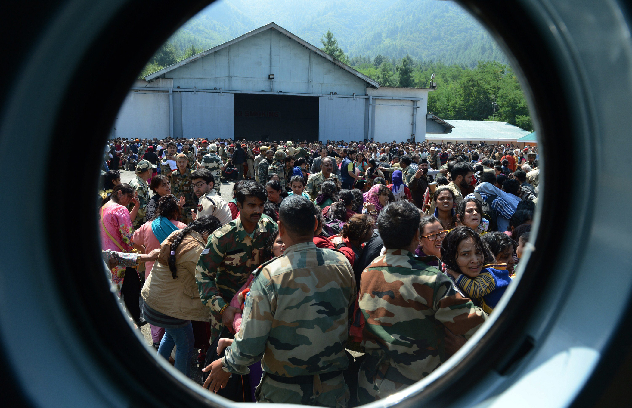 Tourists wait to be evacuated by Indian Air Force helicopters during rescue and relief operations following flooding in Srinagar on Sept. 10, 2014.