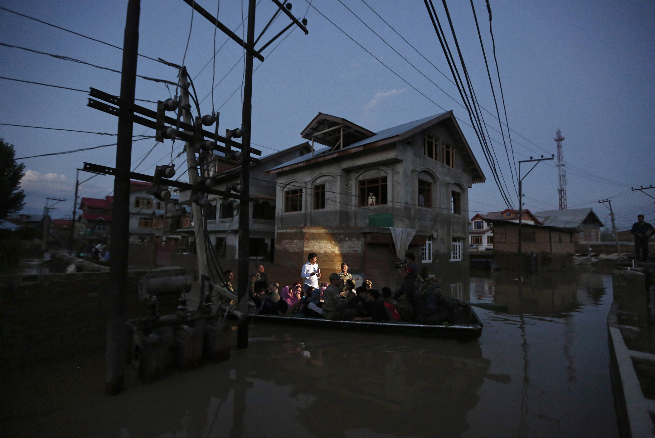 Flood victims are evacuated by boat from their flooded house in Srinagar, Sept. 10, 2014.
