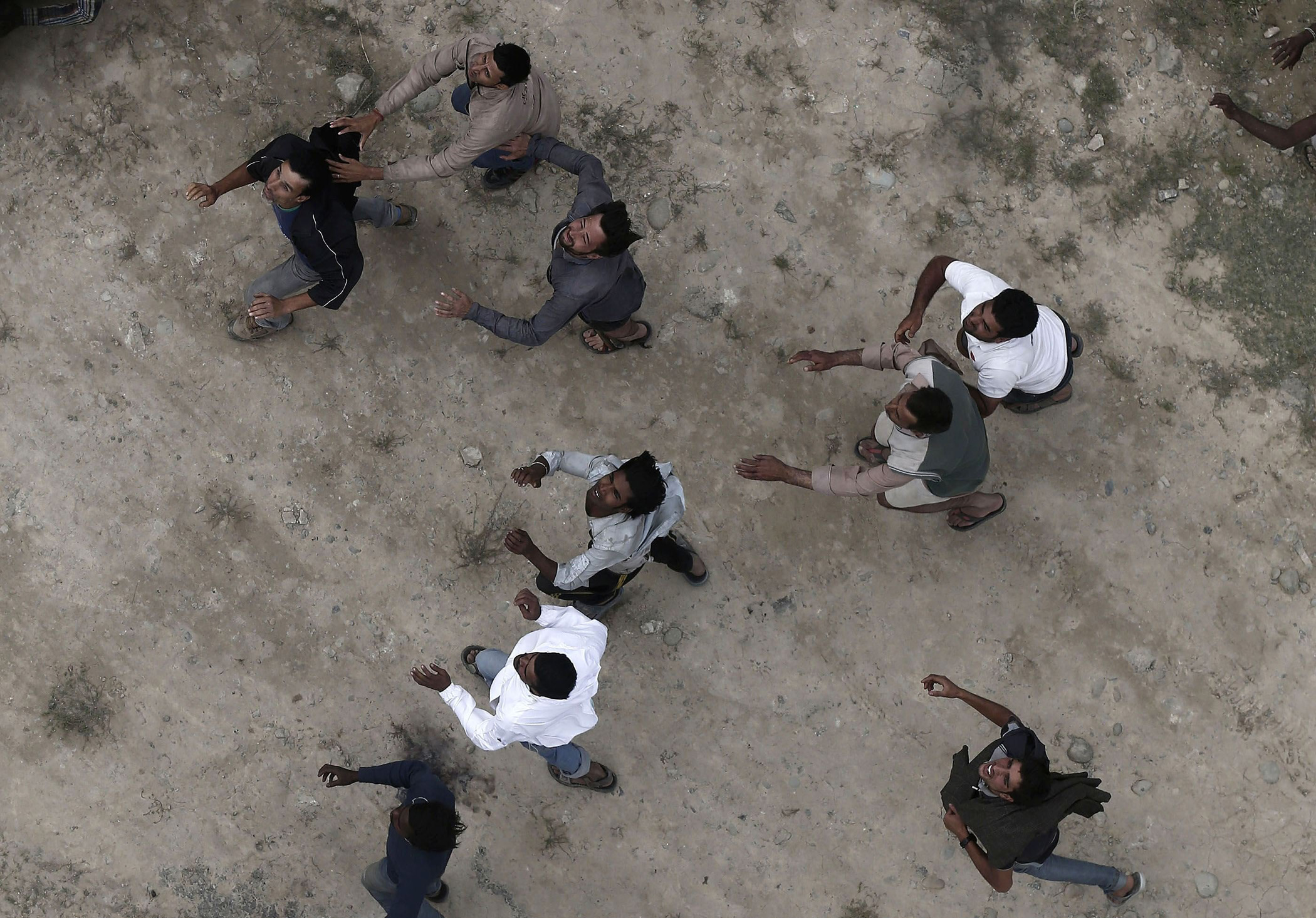 Flood victims run to collect food packages and relief materials dropped from an Indian Air Force helicopter in Srinagar, Sept. 11, 2014.