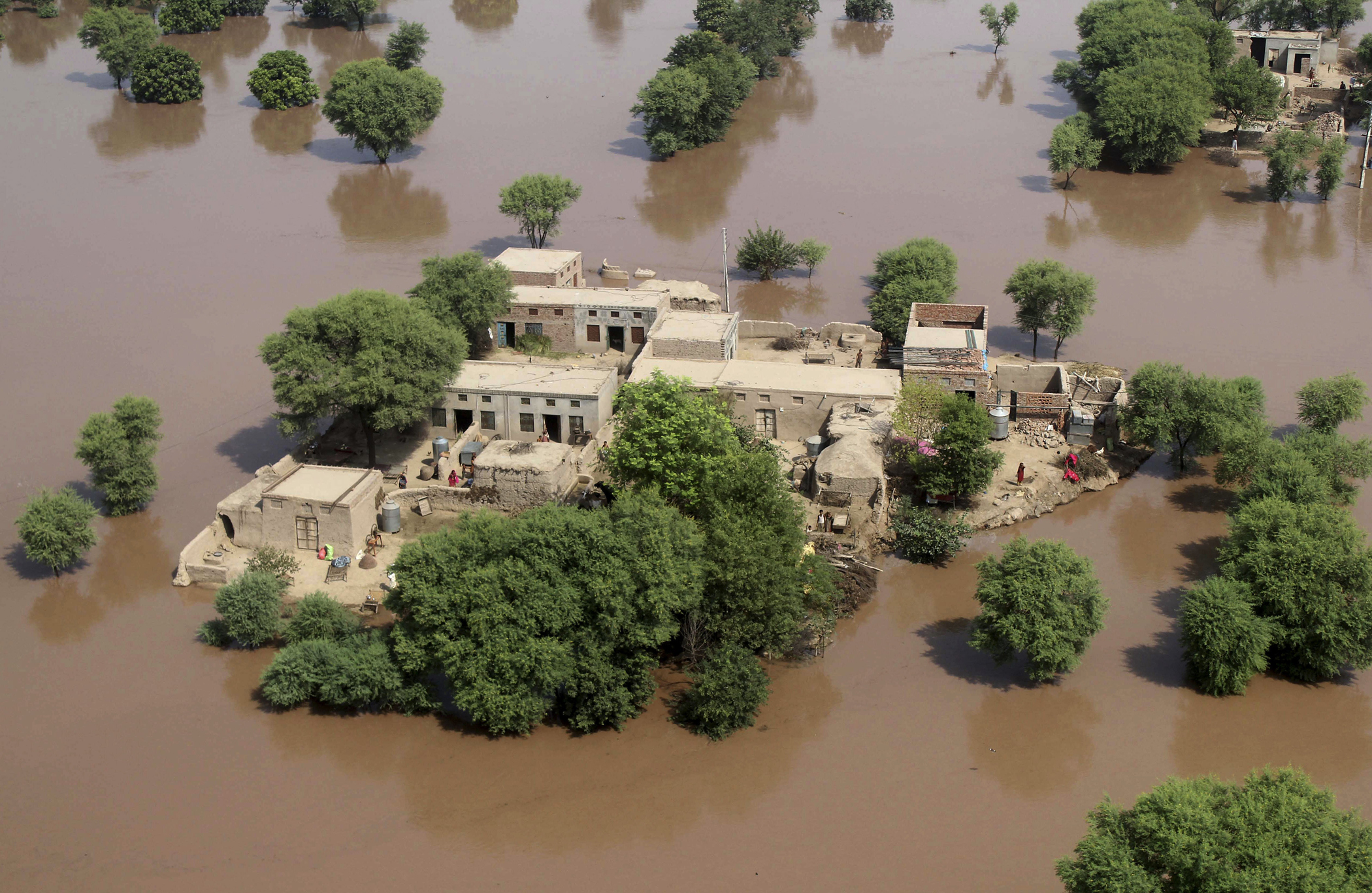 An aerial view shows houses surrounded by flood waters in district Multan, Pakistan, Sept. 12, 2014.