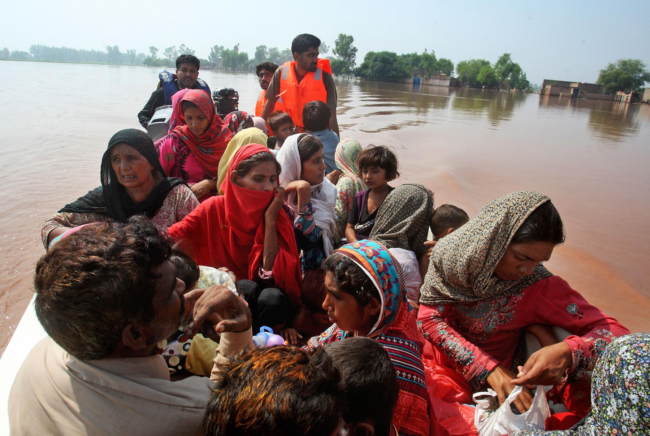 Pakistani volunteers rescue villagers in Chiniot, 100 miles northwest of Lahore, Pakistan, Sept. 9, 2014.