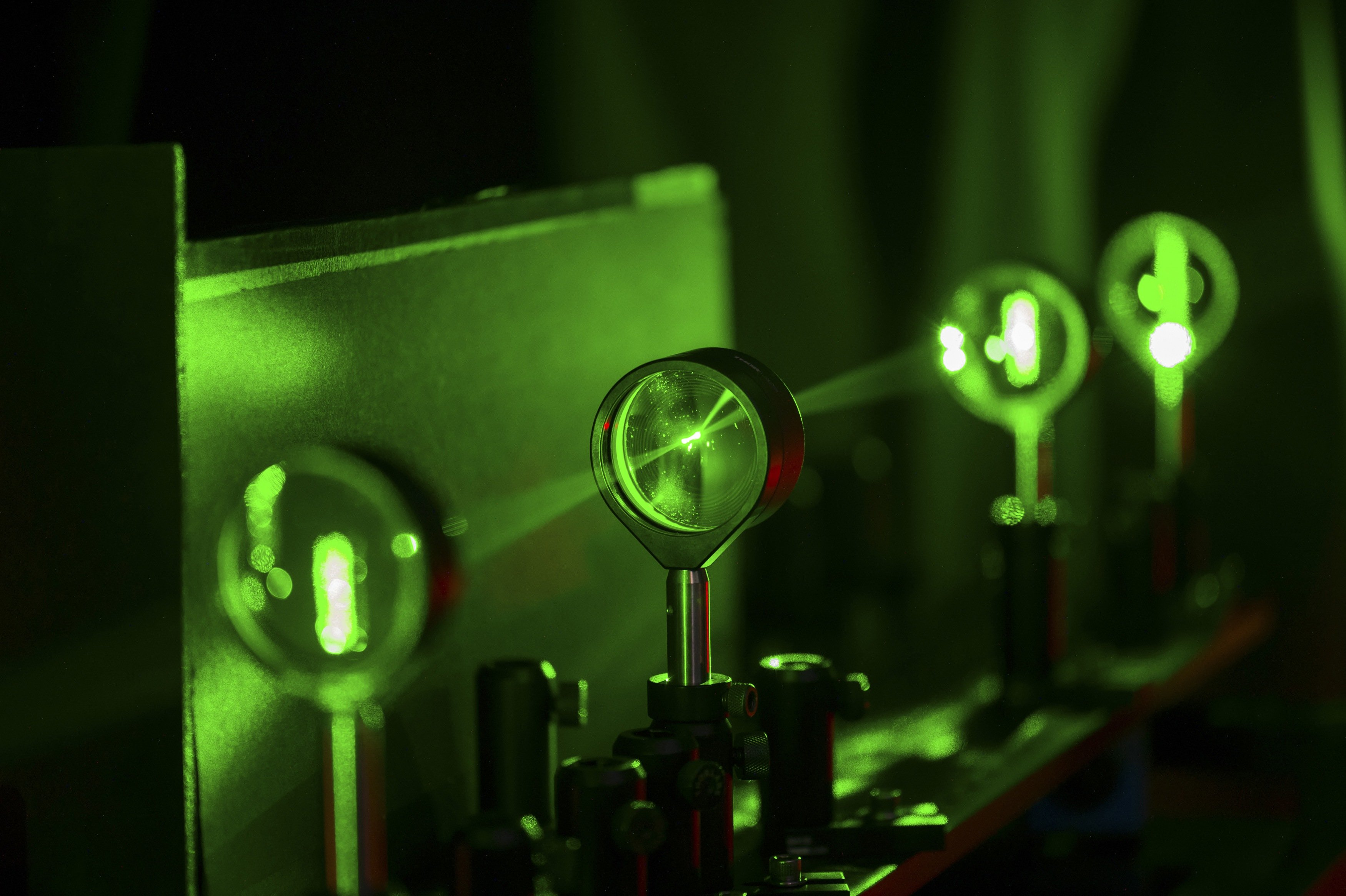 A cloaking device using four lenses developed by University of Rochester physics professor John Howell and graduate student Joseph Choi is demonstrated in Rochester, New York on Sept. 11, 2014.