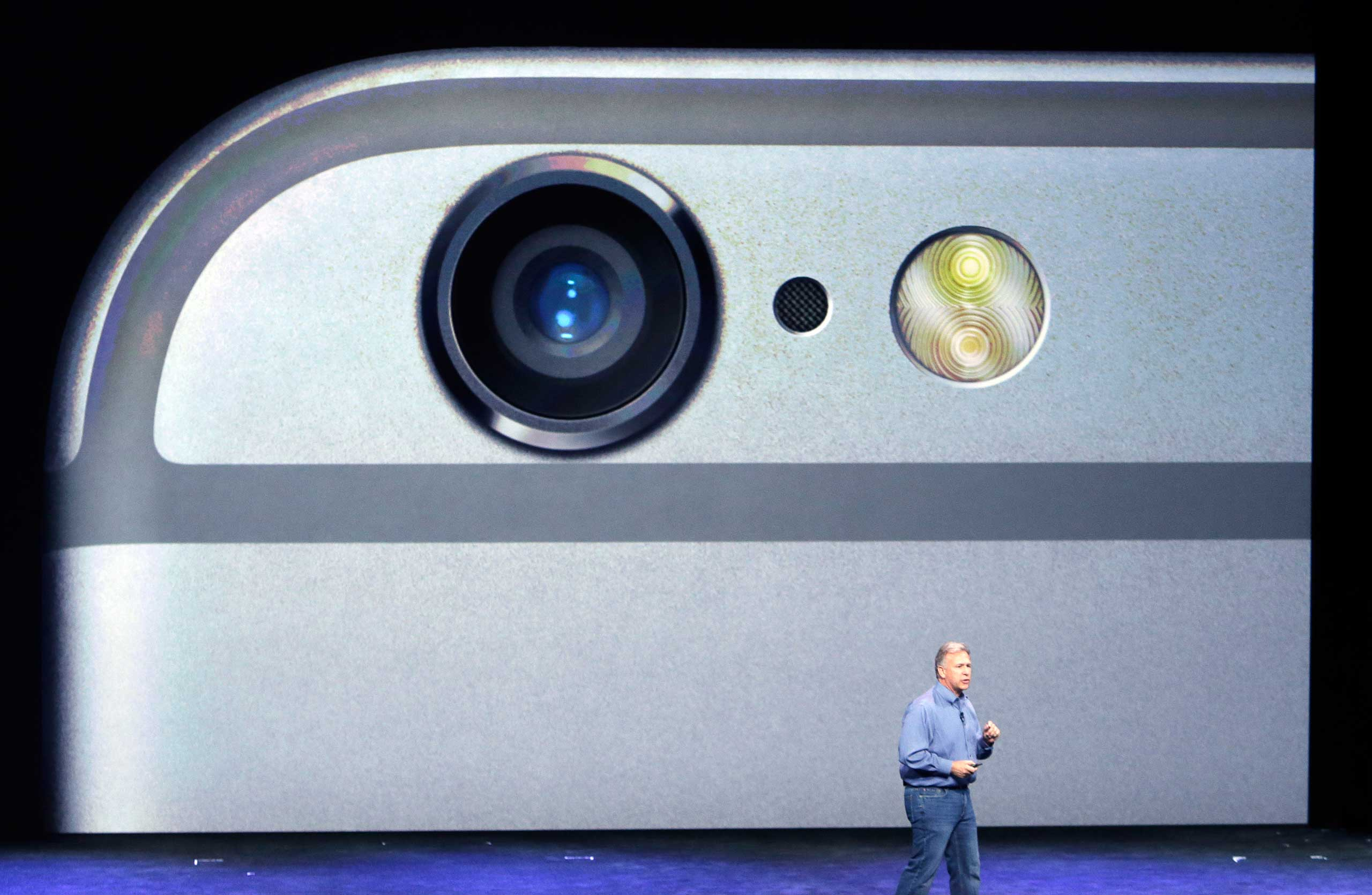 Phil Schiller, Apple's senior vice president of worldwide product marketing, discusses the camera features on the new iPhone 6 and iPhone 6 plus on Sept. 9, 2014, in Cupertino, Calif.
