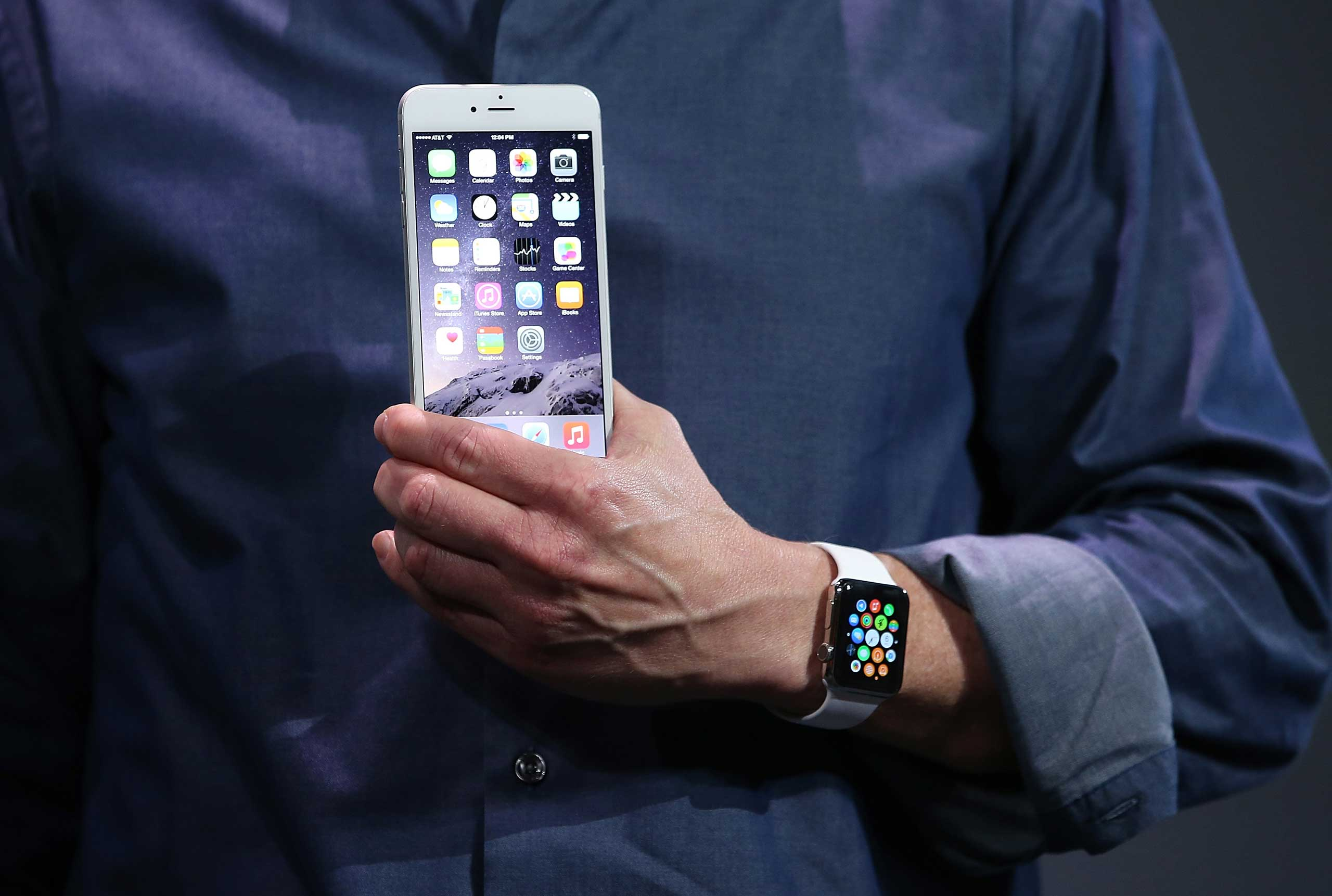 Apple CEO Tim Cook shows off the new iPhone 6 and the Apple Watch during an Apple special event at the Flint Center for the Performing Arts in Cupertino, Calif., September 9, 2014.