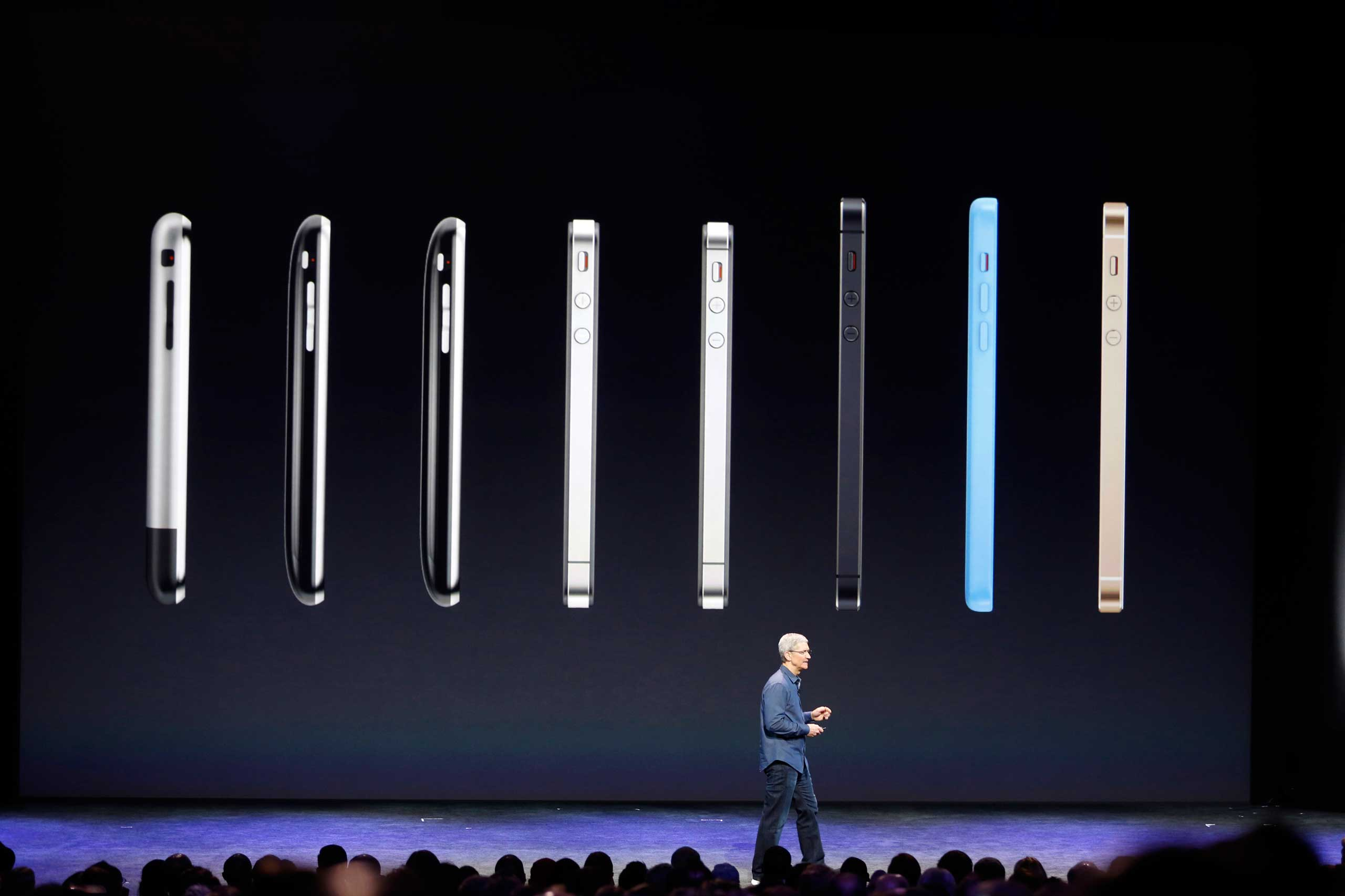 Apple CEO Tim Cook speaks in front of a row of iPhones during an Apple event at the Flint Center in Cupertino, Calif. on September 9, 2014.