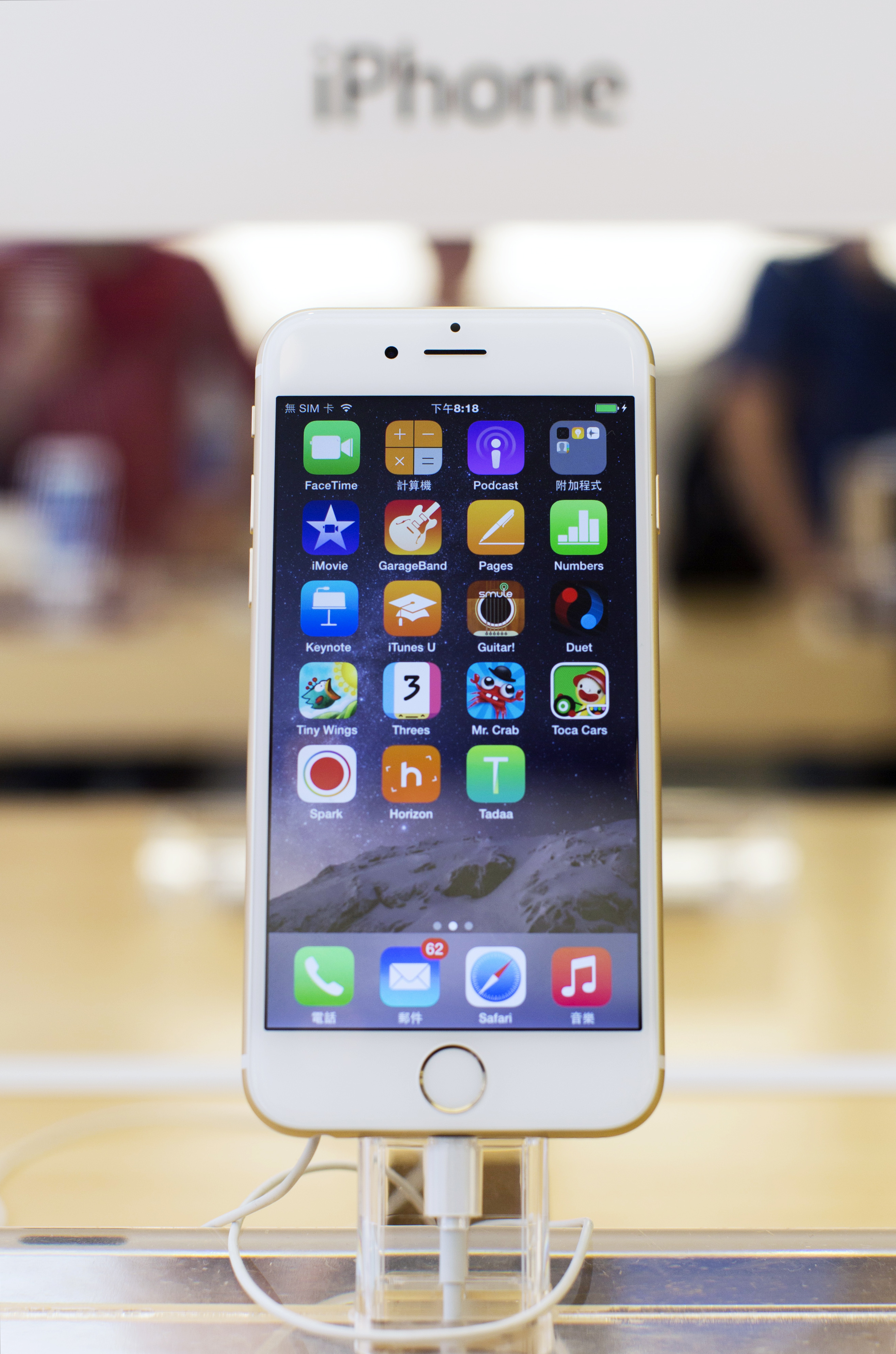 An Apple Inc. iPhone 6 stands on display at the company's Causeway Bay store during the sales launch of the iPhone 6 and iPhone 6 Plus in Hong Kong, China, on Friday, Sept. 19, 2014.