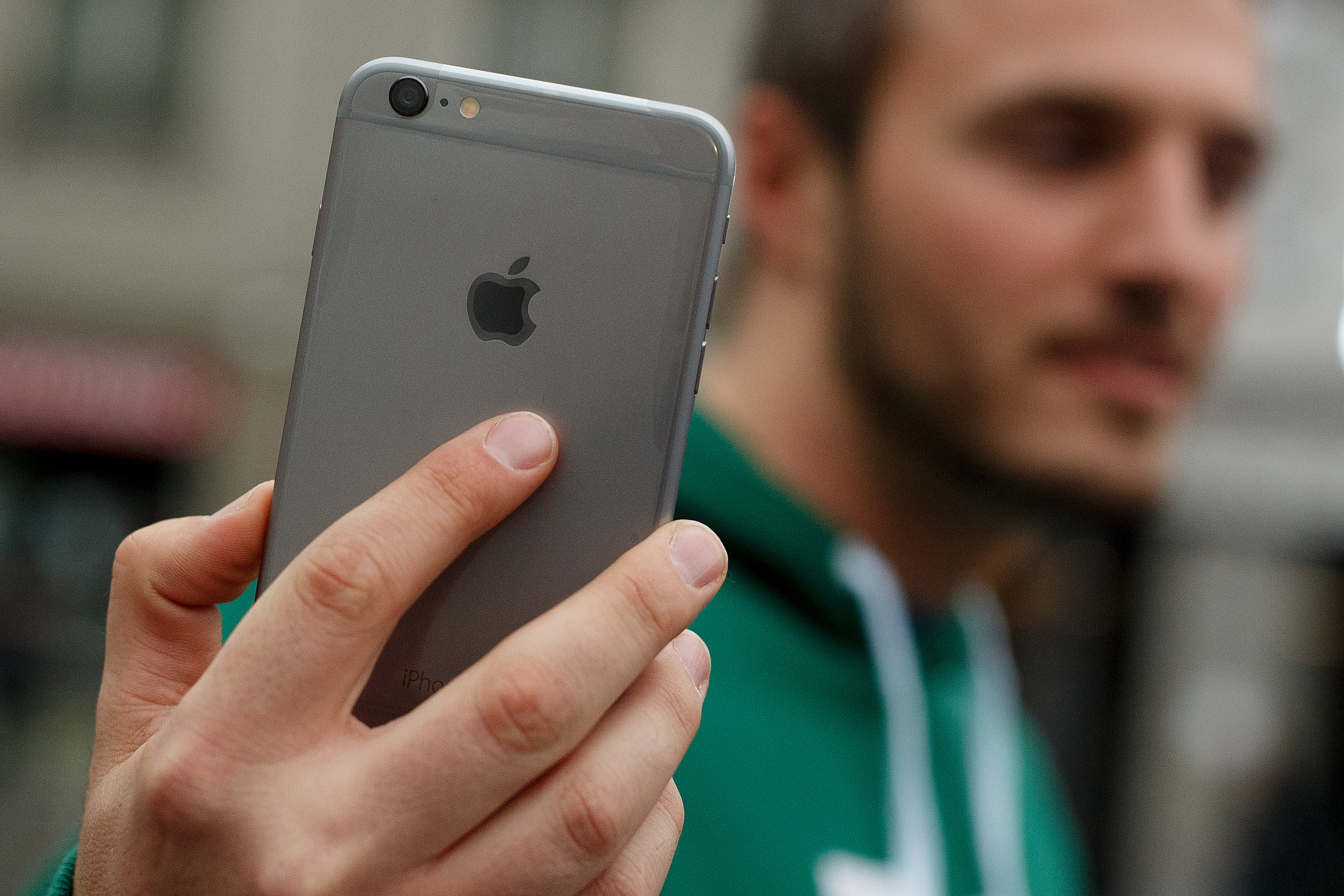 A man shows his new iPhone outside Puerta del Sol Apple Store as Apple launches iPhone 6 and iPhone 6 Plus on September 26, 2014 in Madrid, Spain.