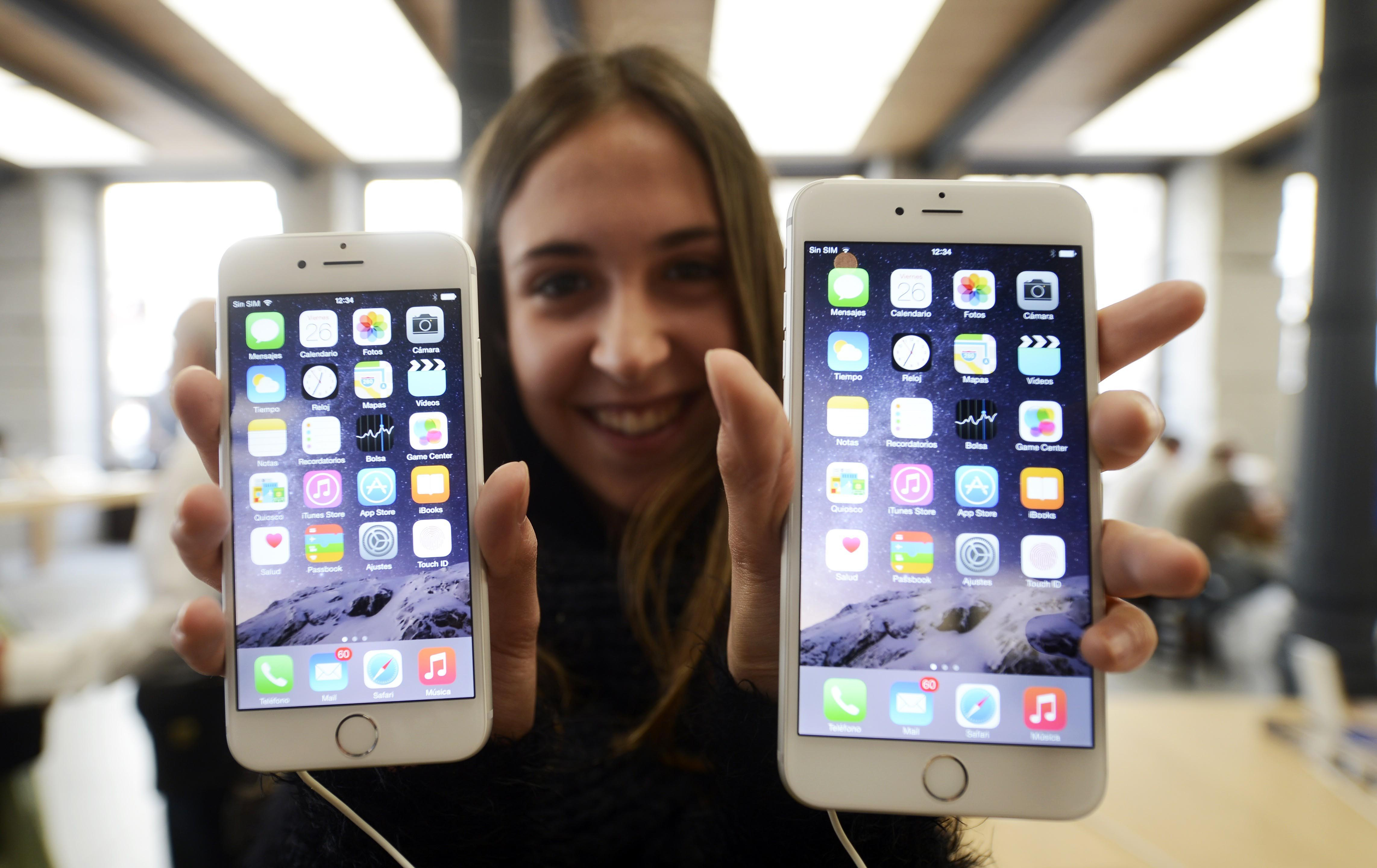 A customer shows the new products of Apple, iPhone 6 and iPhone 6 Plus, at an Apple Store in Madrid, Spain, on September 26, 2014.
