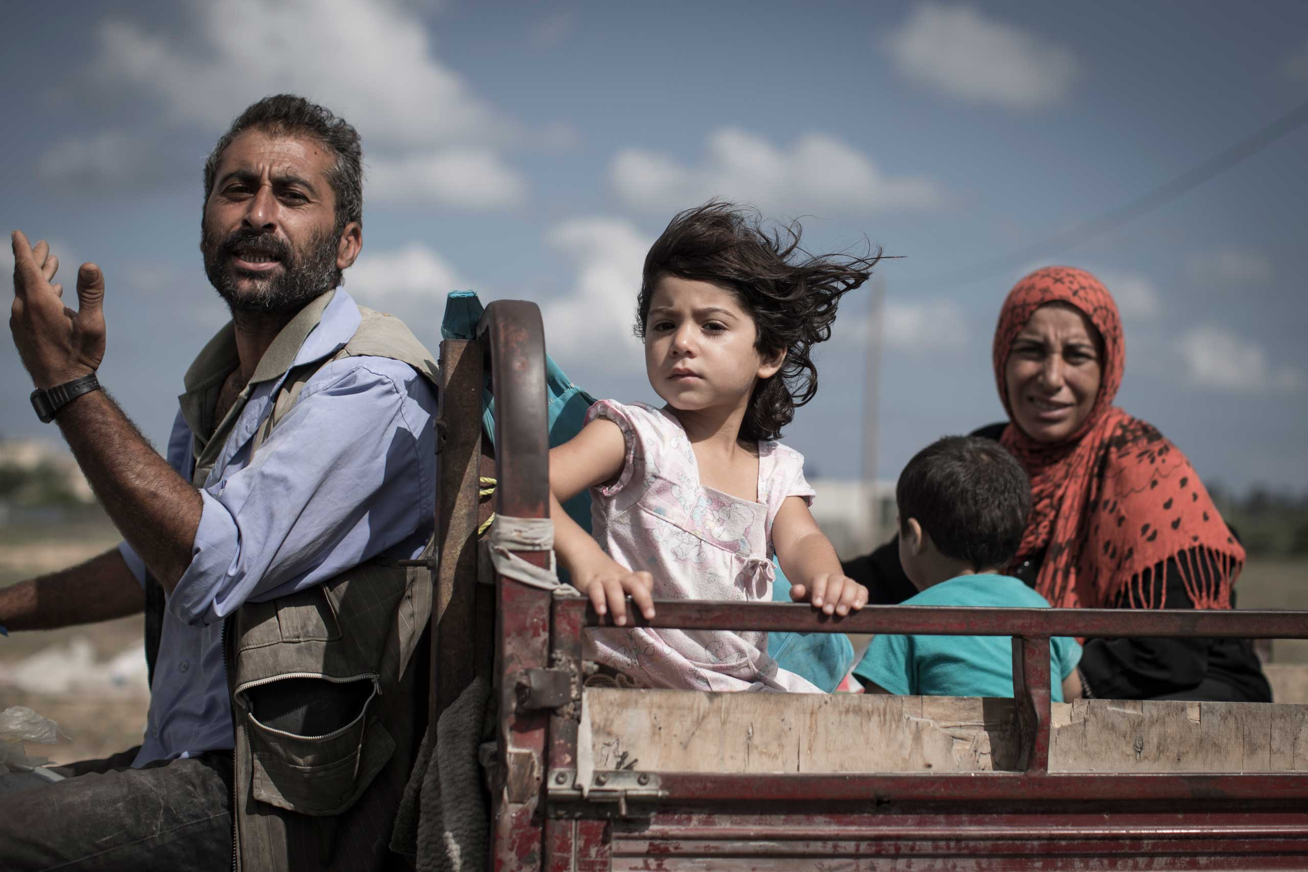 A Palestinian family who fled their home is en route to seek shelter at a U.N. school in Khan Younis, central Gaza Strip, July 18, 2014.