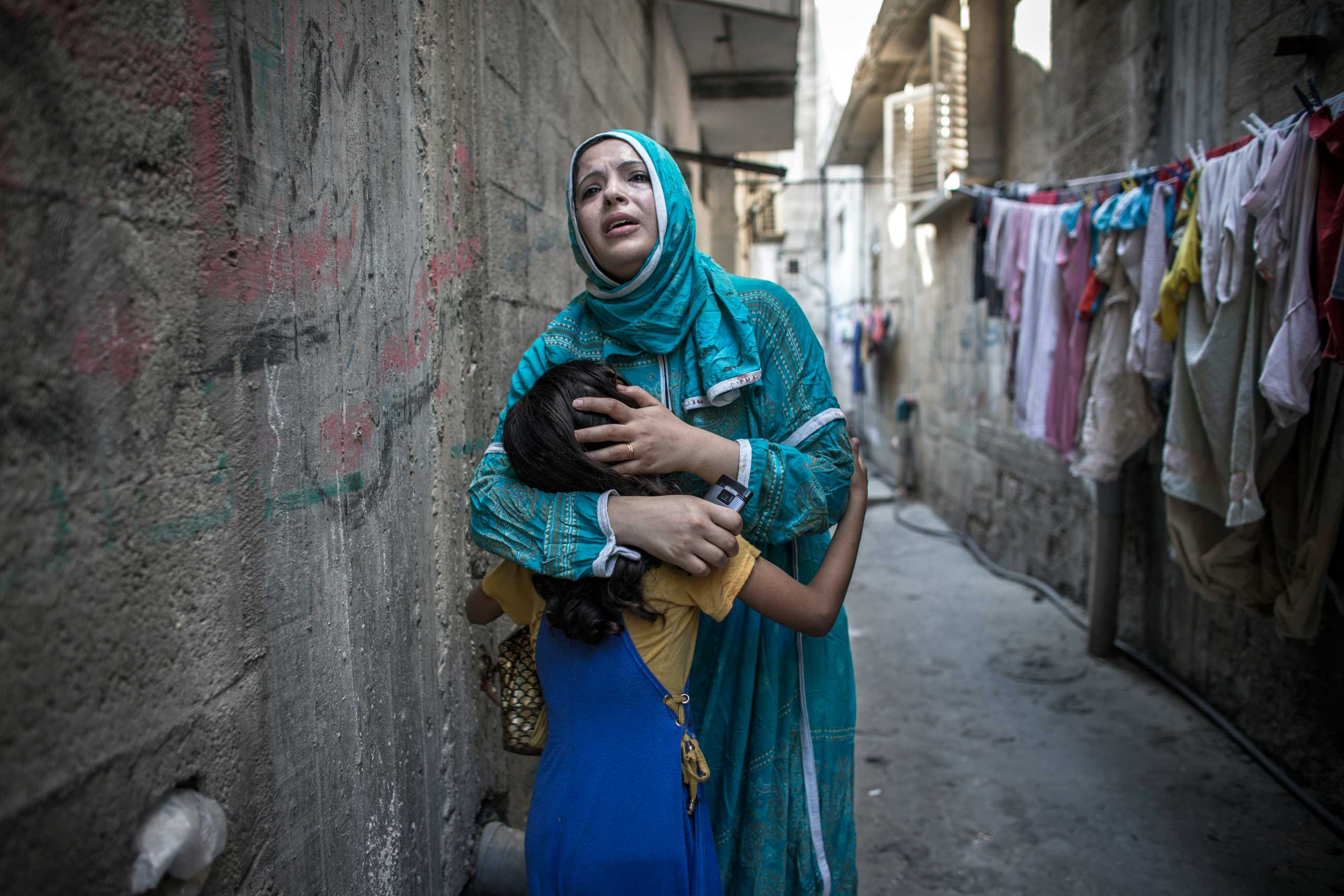 Young Palestinians react shortly after an airstrike, Gaza City, July 28, 2014.
