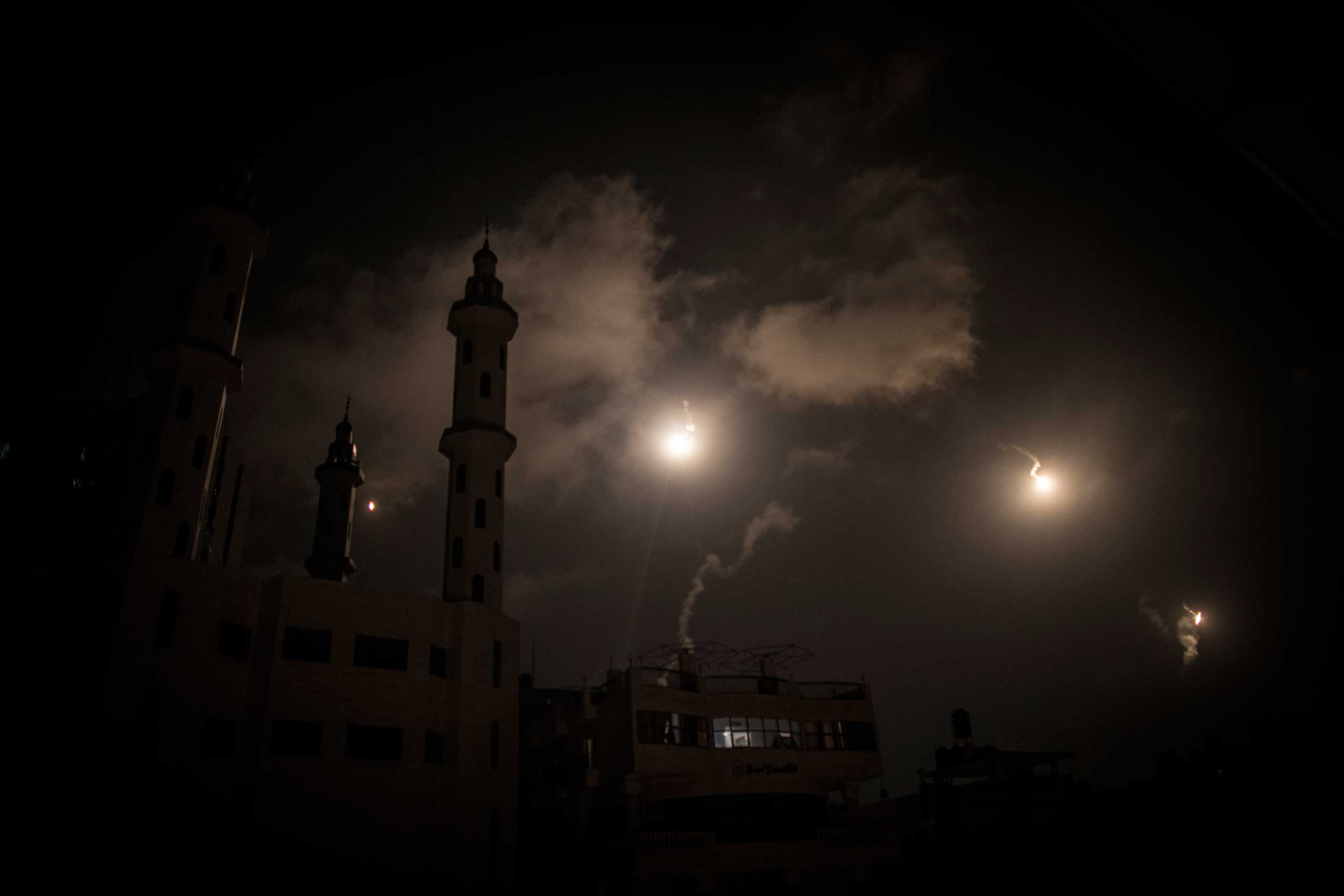 Illumination flares shot by Israel Defense Forces illuminate the minaret of a mosque, Gaza City, July 29, 2014.