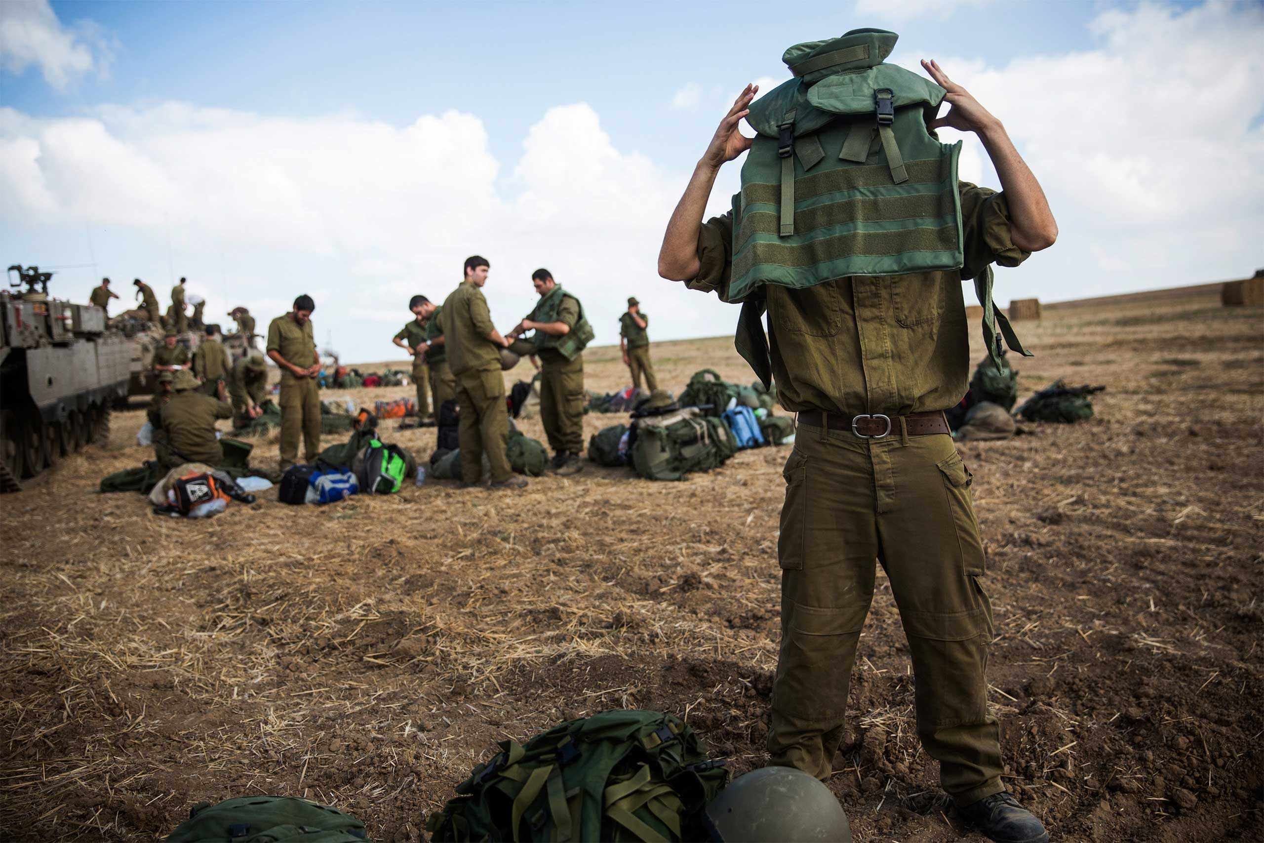Israeli reservists troops arrive for duty close to the Israel-Gaza border near Sderot, Israel, on the morning of July 18, 2014.