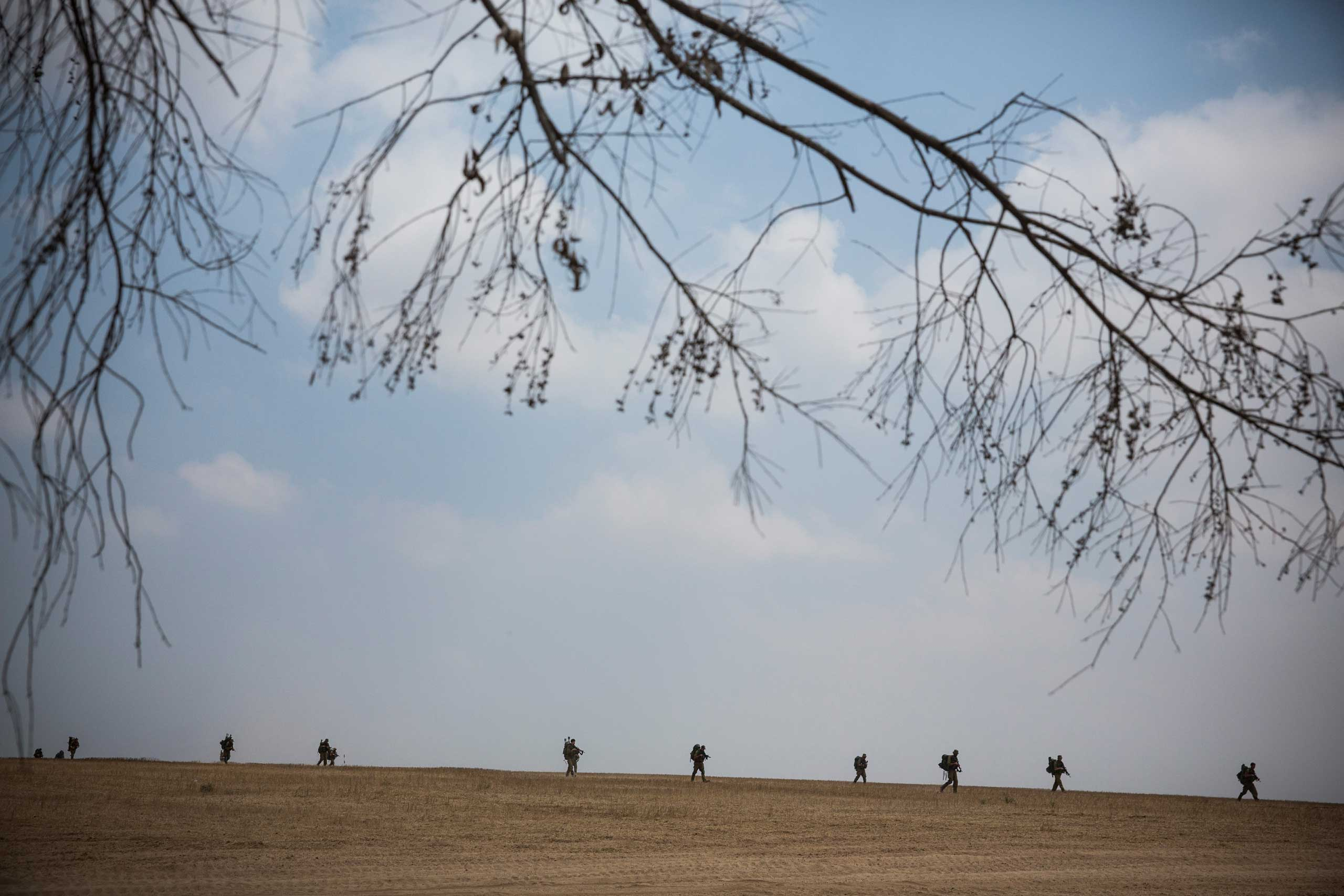 Israeli soldiers practice training missions close to the Israel-Gaza border as seen from near Sderot, Israel, July 22, 2014.