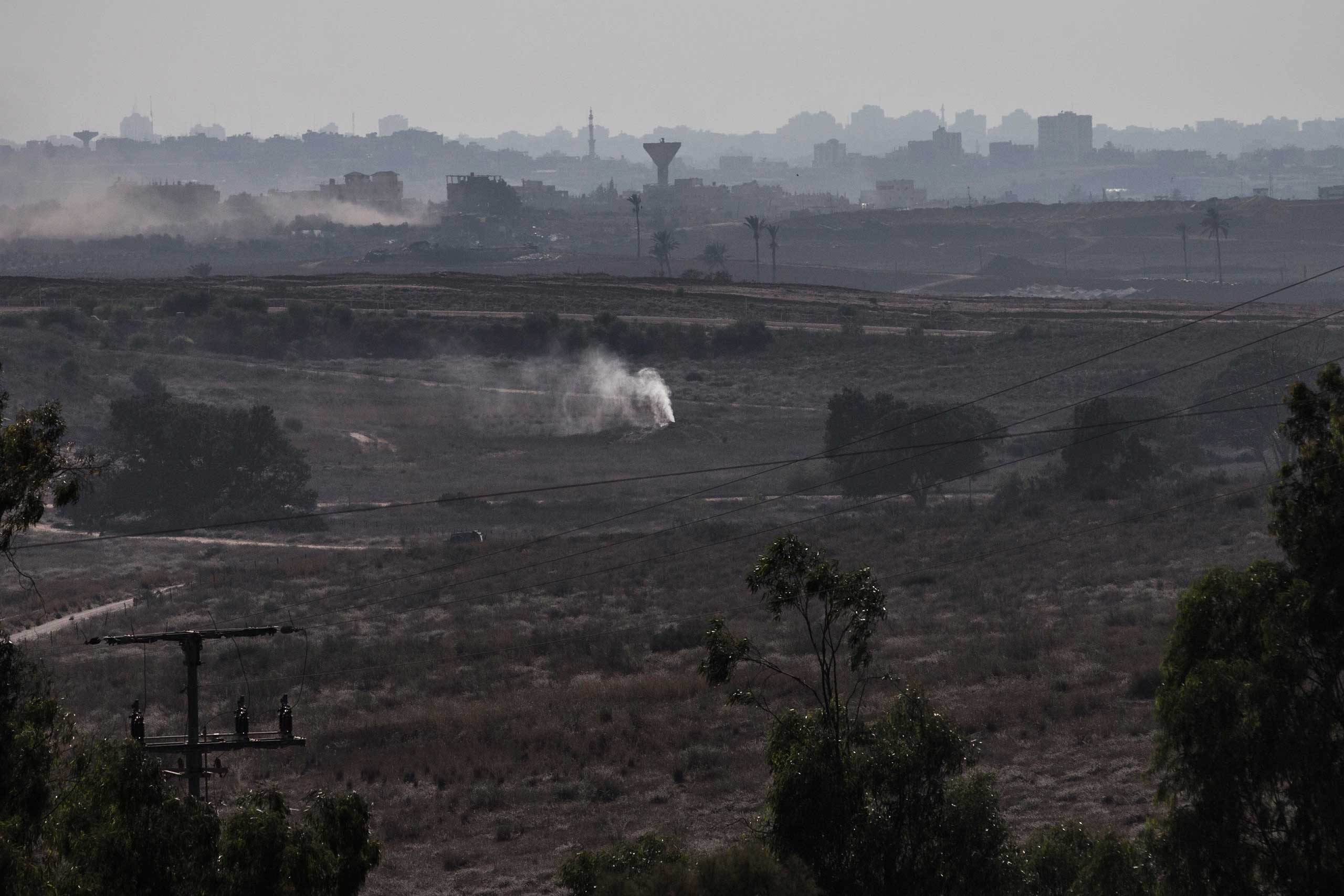 Smoke pours out of the ground due to an alleged campaign by the Israeli military to fill tunnels originating in Gaza with smoke to discover entrances into Israel near Sderot, Israel, July 23, 2014.