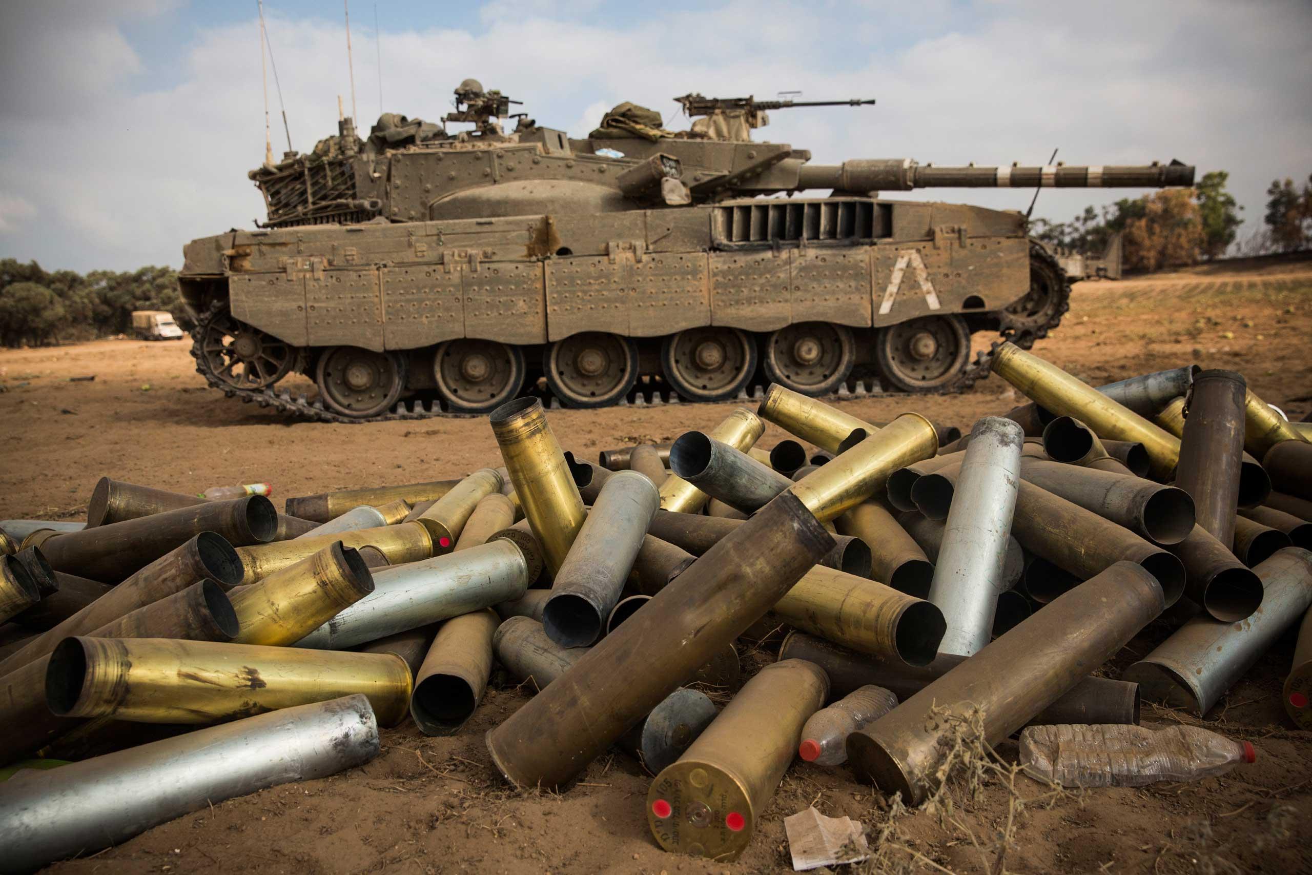 Used artillery shells litter the ground near Kfar Aza, Israel, on the morning of July 28, 2014.