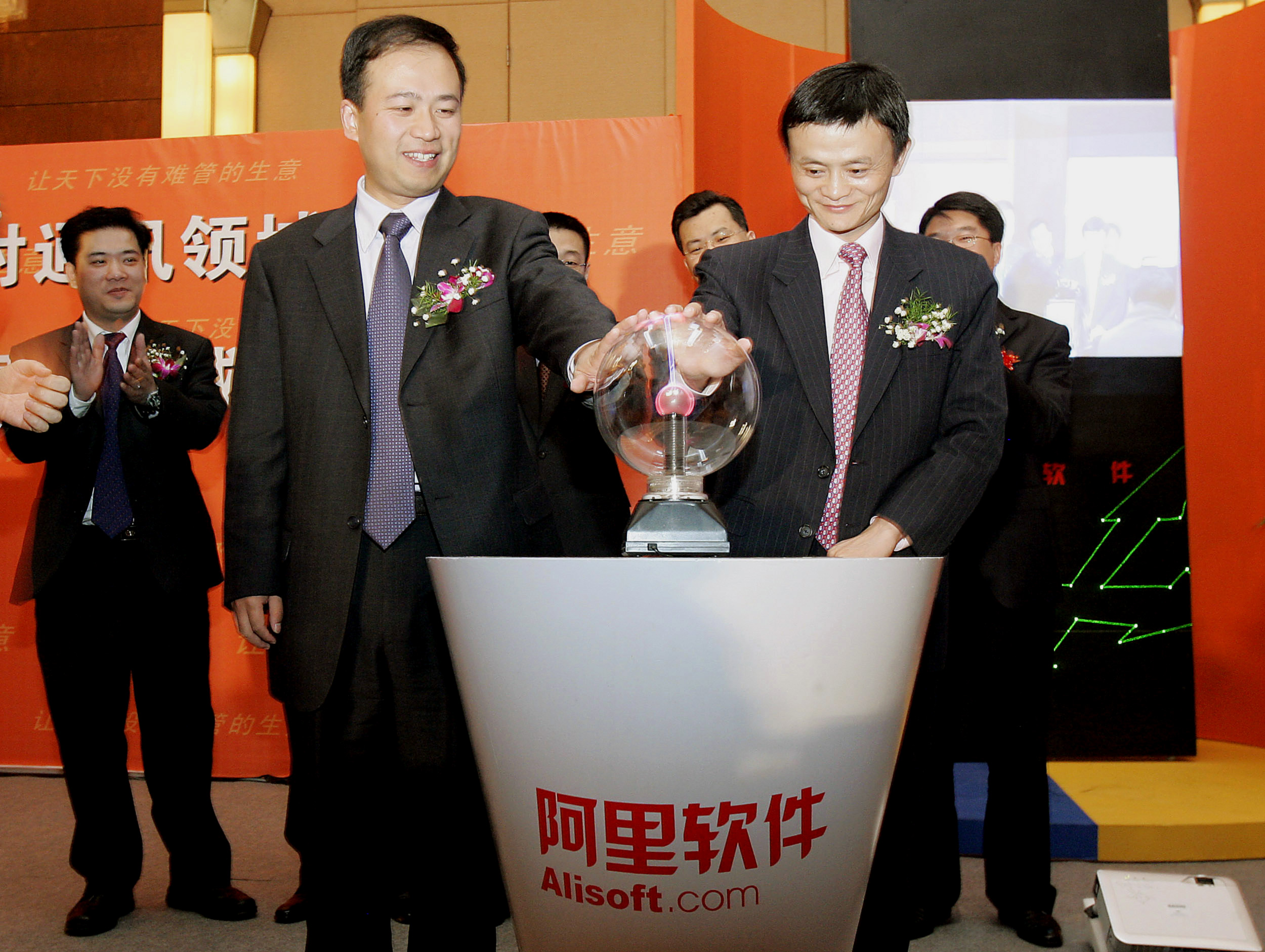 Holding a crystal ball-like orb is a good way to introduce a new software product, if you ask Ma. Here, he and Alibaba.com Vice President Oliver Wang touch a device to signify the launch of the ALISOFT software during a news conference in 2007 in Shanghai, China.