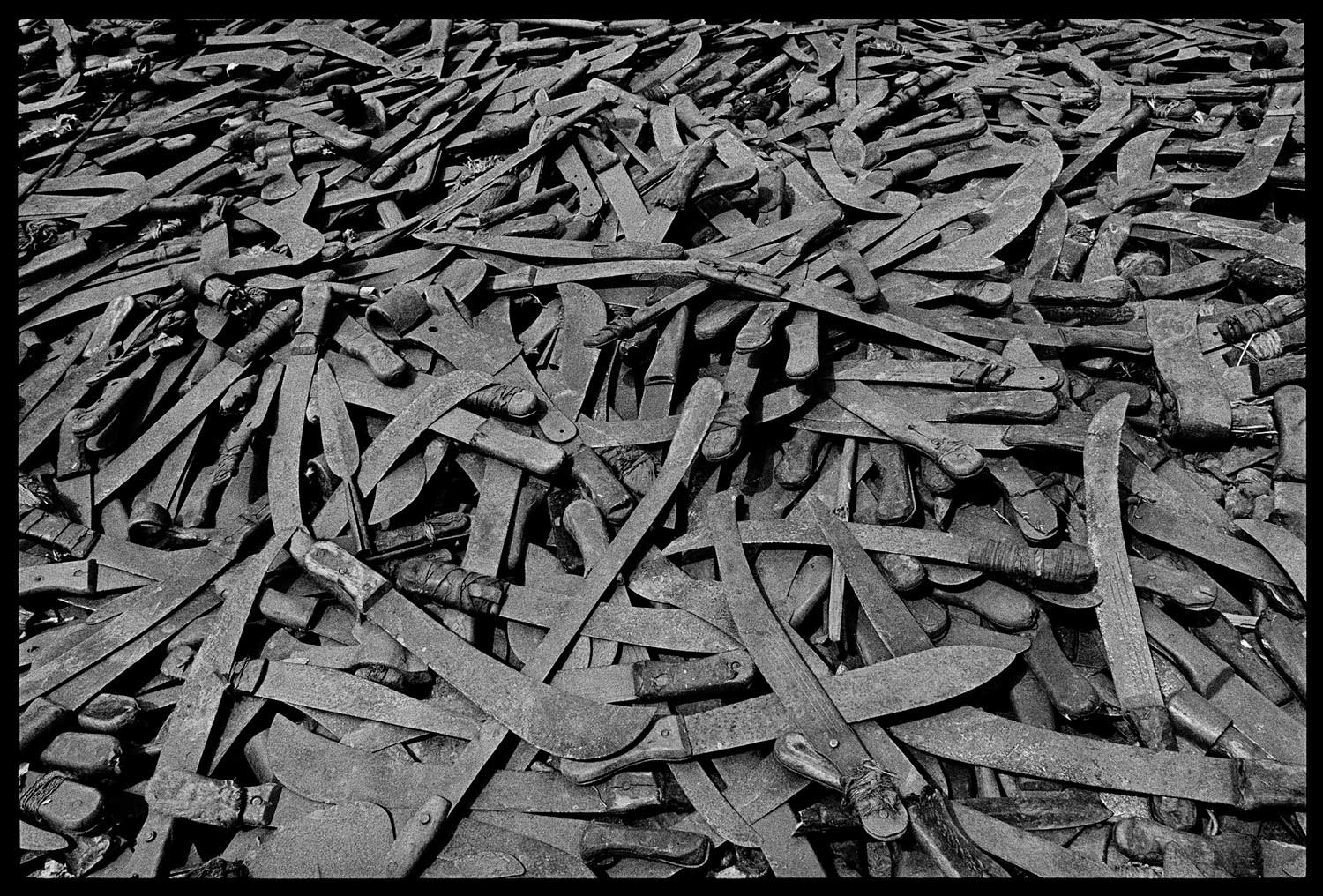 As the vanquished Hutus fled into Tanzania, they had to leave at the border the weapons with which they had committed the genocide, Rwanda, 1994.