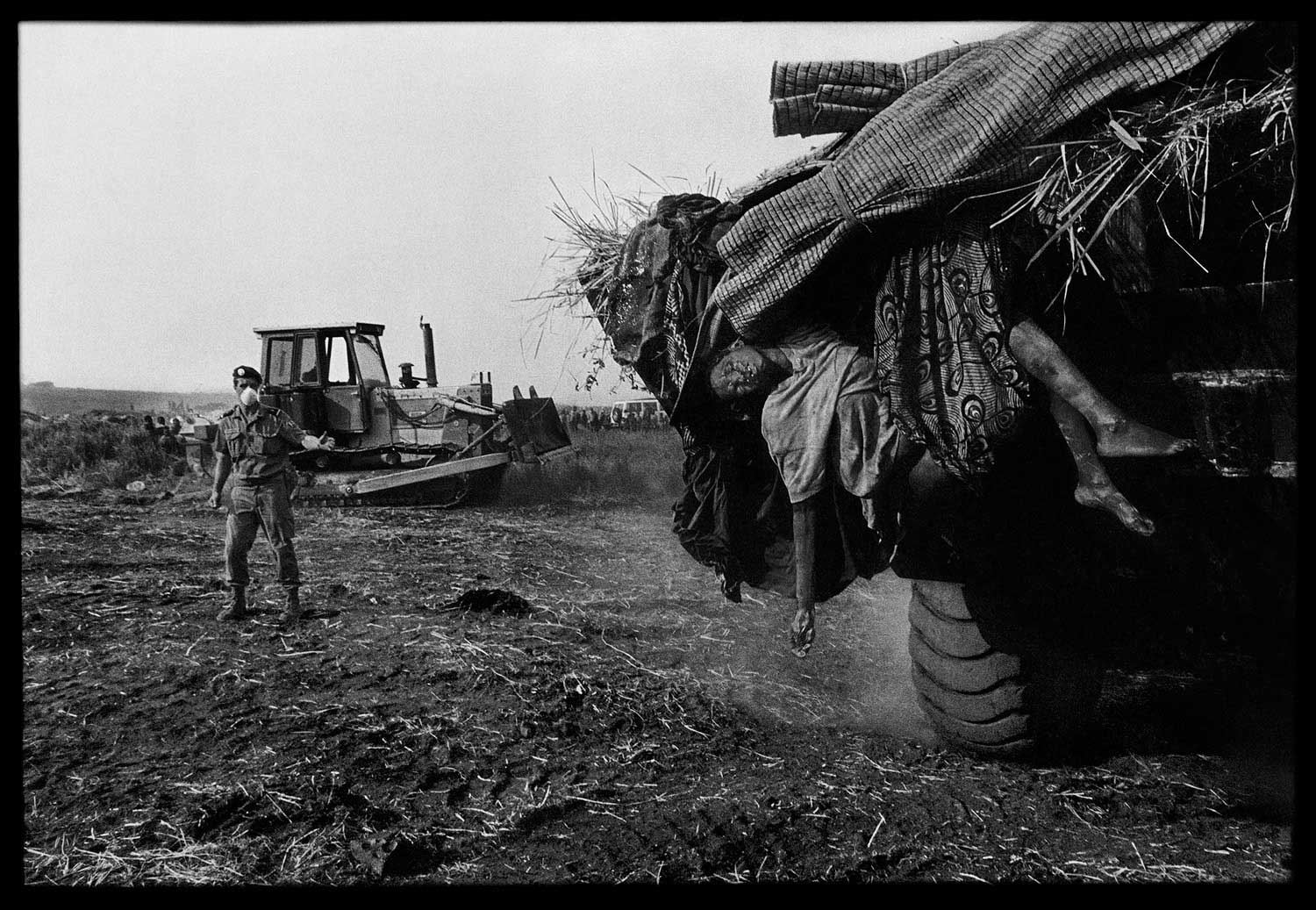 To help stop the deadly momentum of the disease, the French army mobilized earth-moving equipment in Zaire to remove and bury the dead en masse, Zaire, 1994.