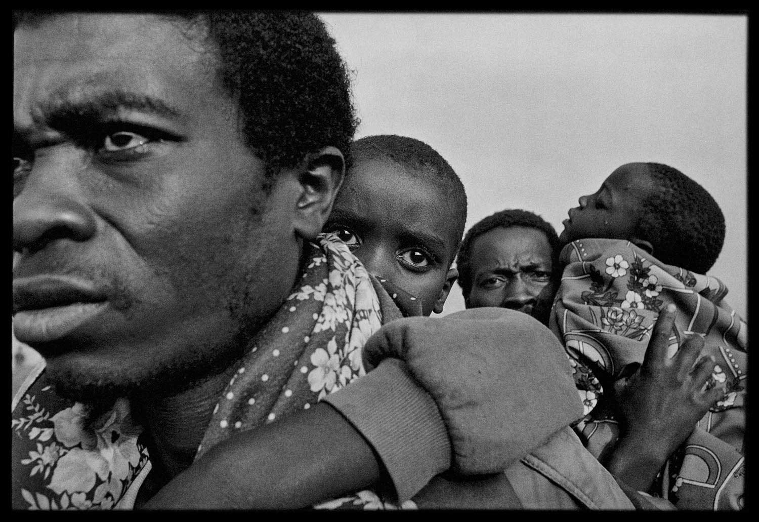 Sick children were carried by their fathers to a clinic in Zaire, 1994.