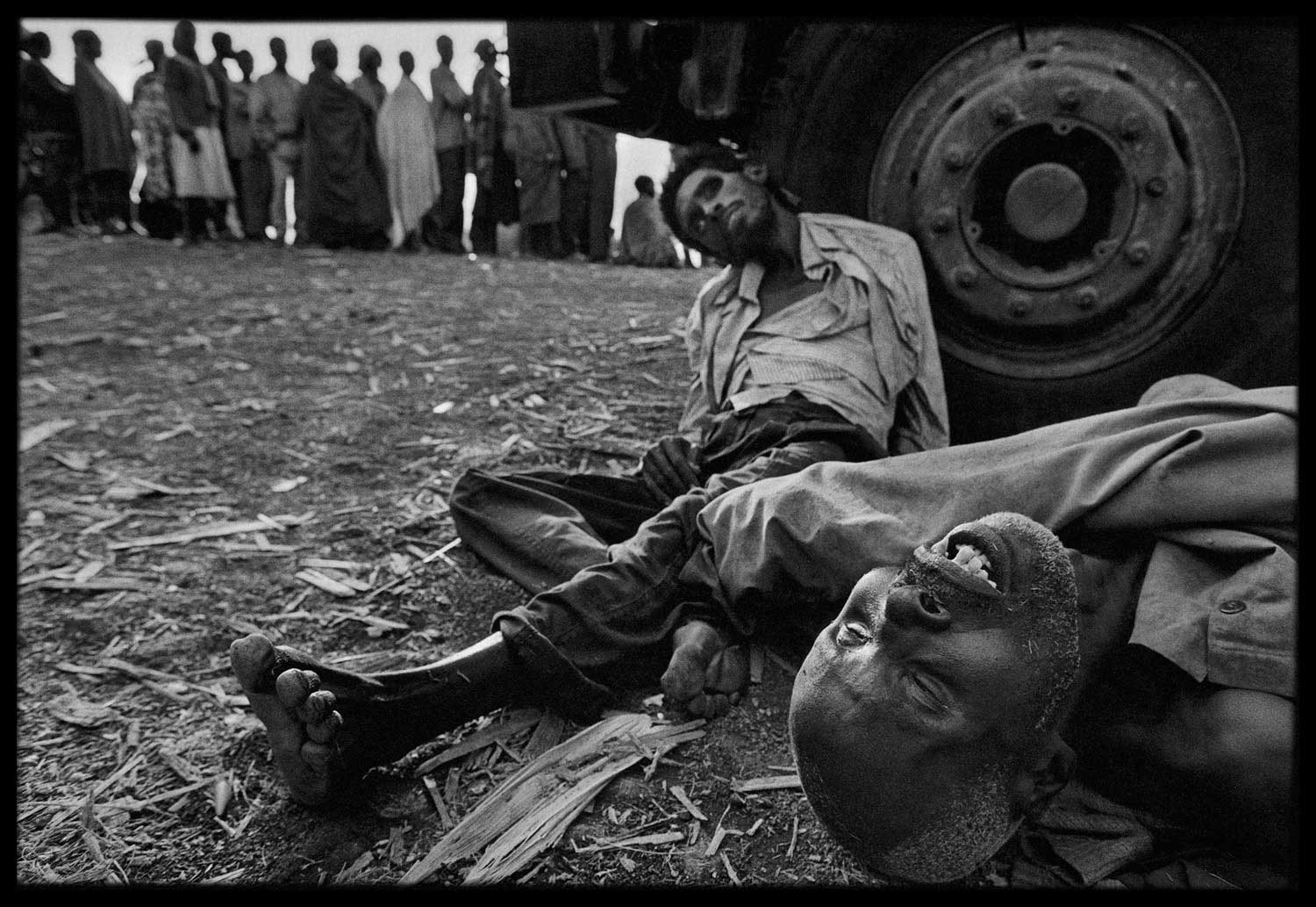 Refugees lined up to receive medical assistance in Zaire. Some died while they waited, Zaire, 1994.