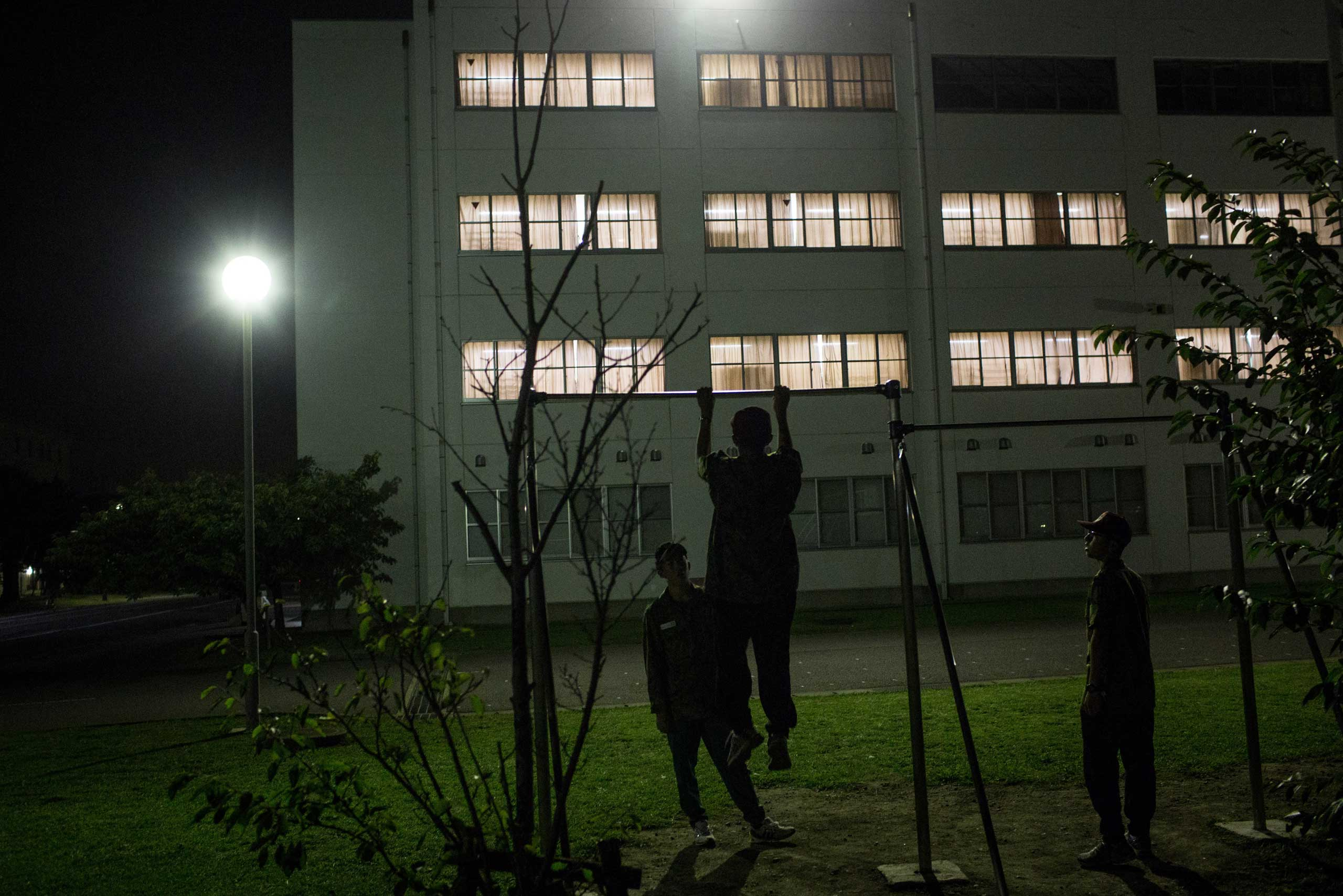 Students do pull-ups during a moment of free time at the end of the day's training.