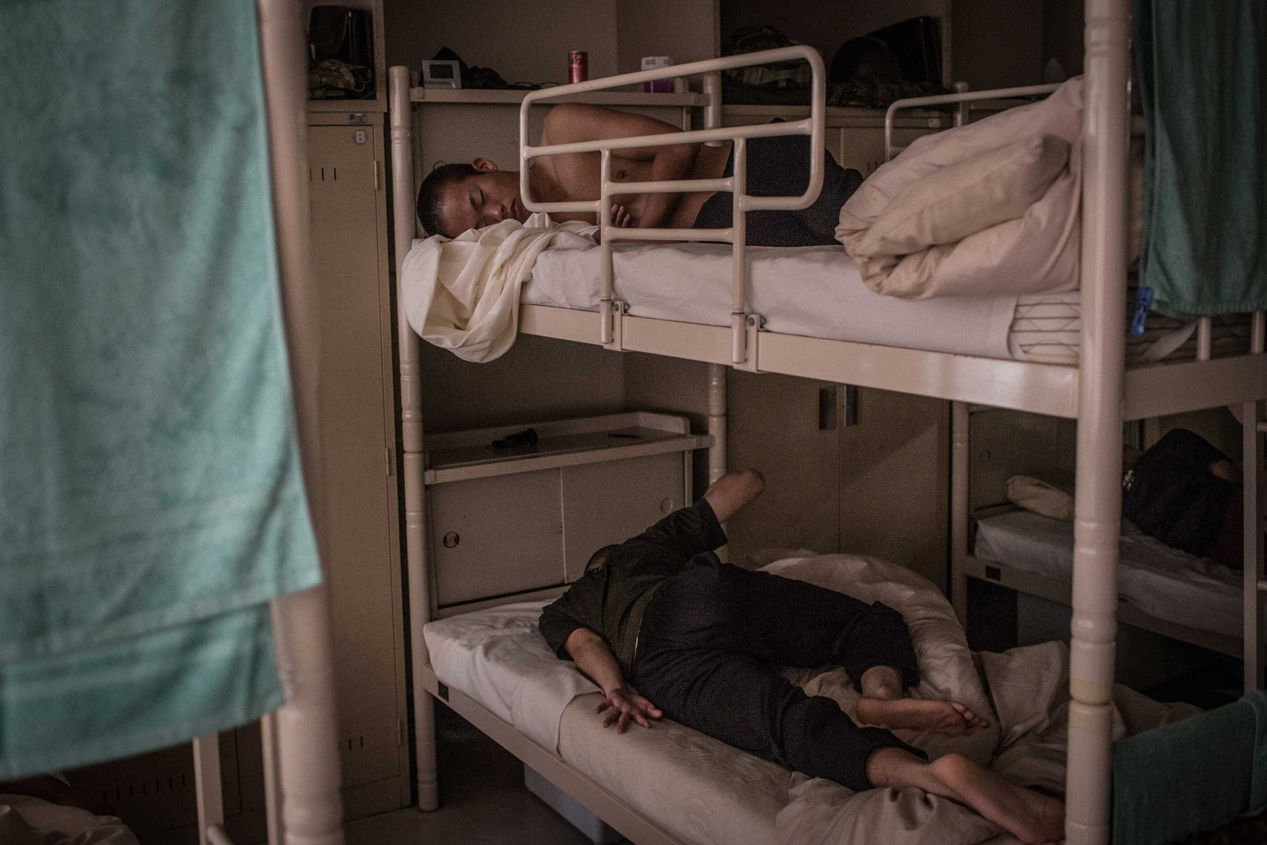 Students sleep in a dormitory.