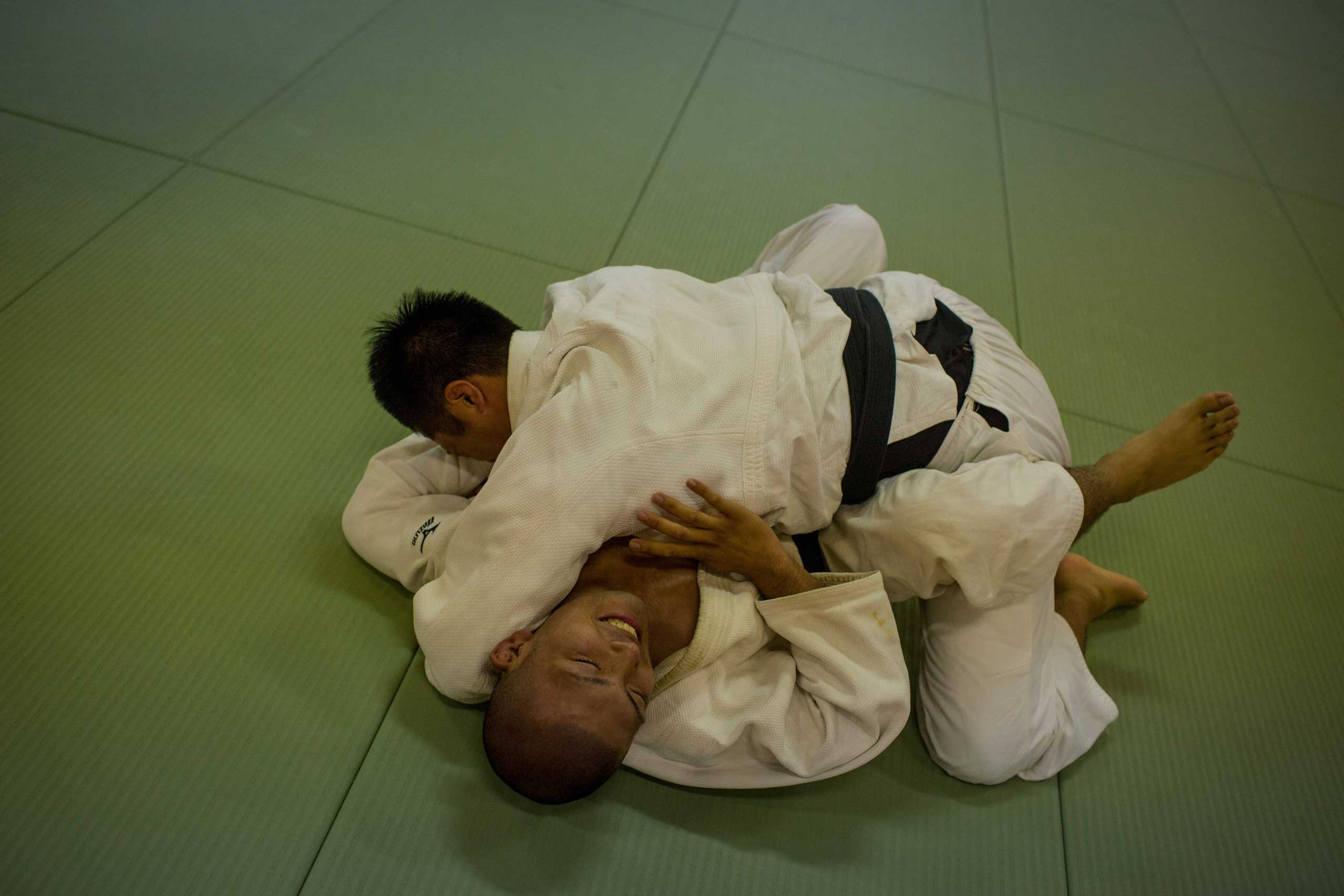 A student grapples with his teacher during Judo classes.