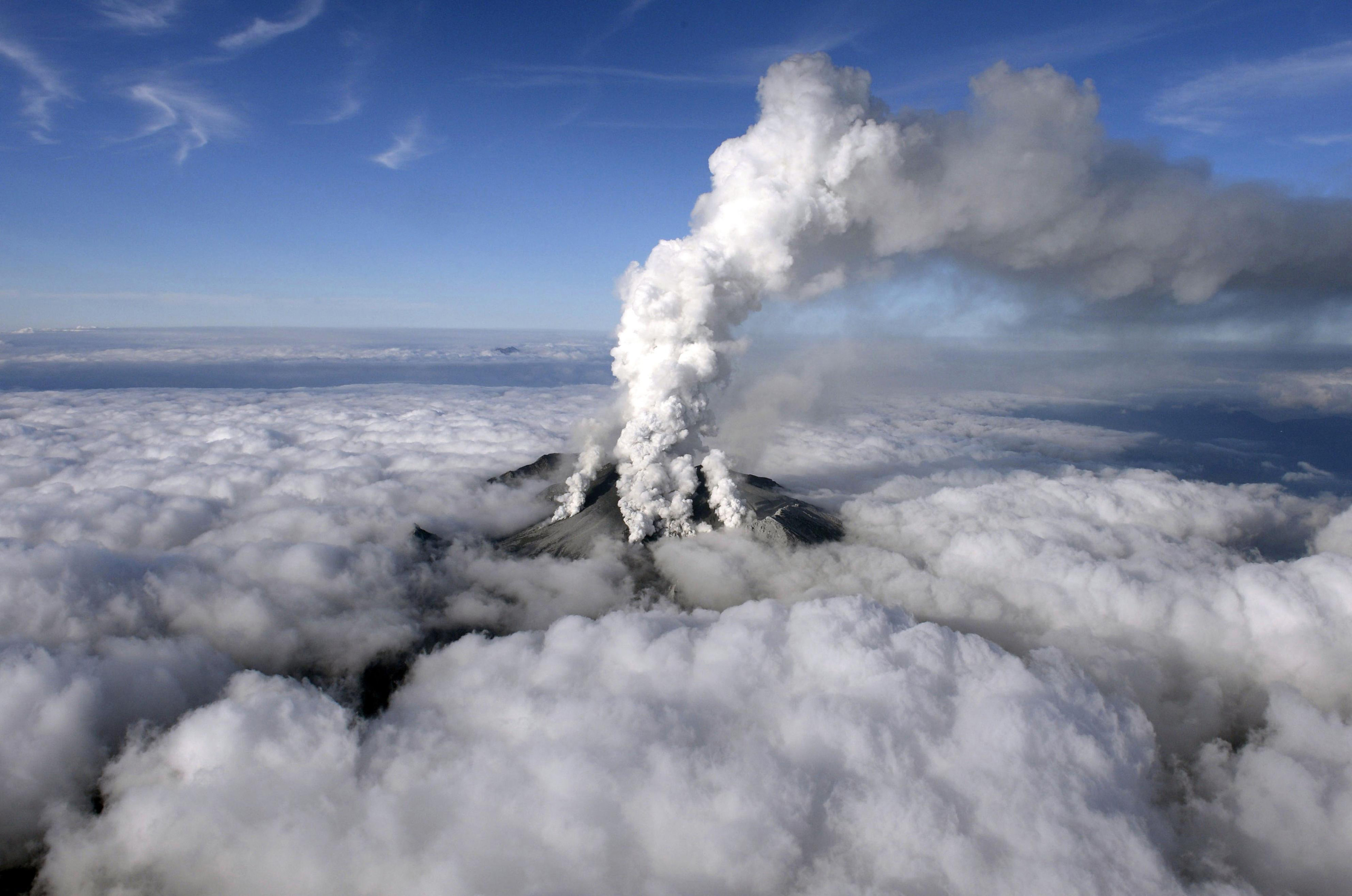 Volcanic smoke rises from Mount Ontake, which straddles Nagano and Gifu prefectures, central Japan on Sept. 27, 2014.