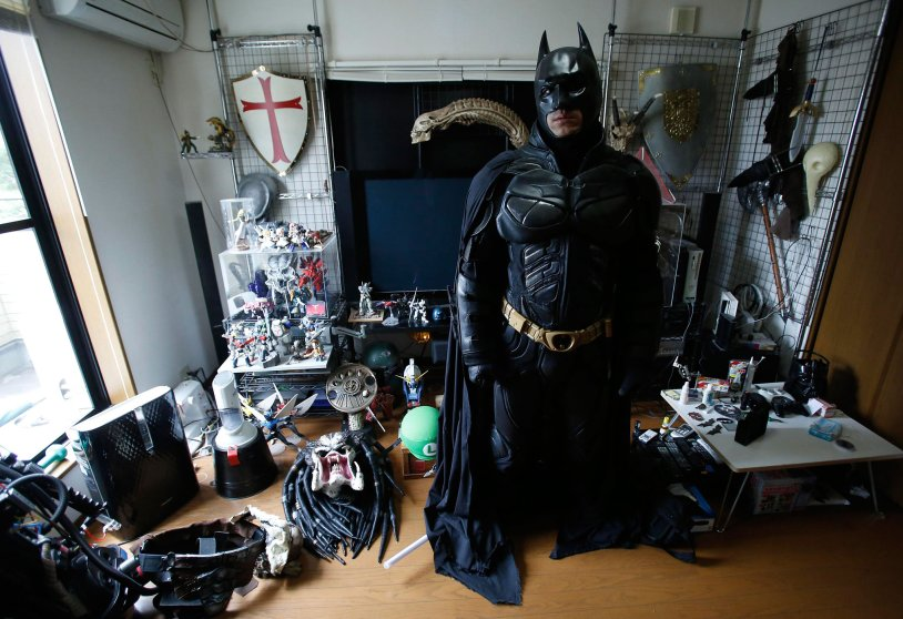 """A 41-year-old man going by the name of Chibatman poses in his room before going on the road on his """"Chibatpod"""" in Chiba, east of Tokyo"""