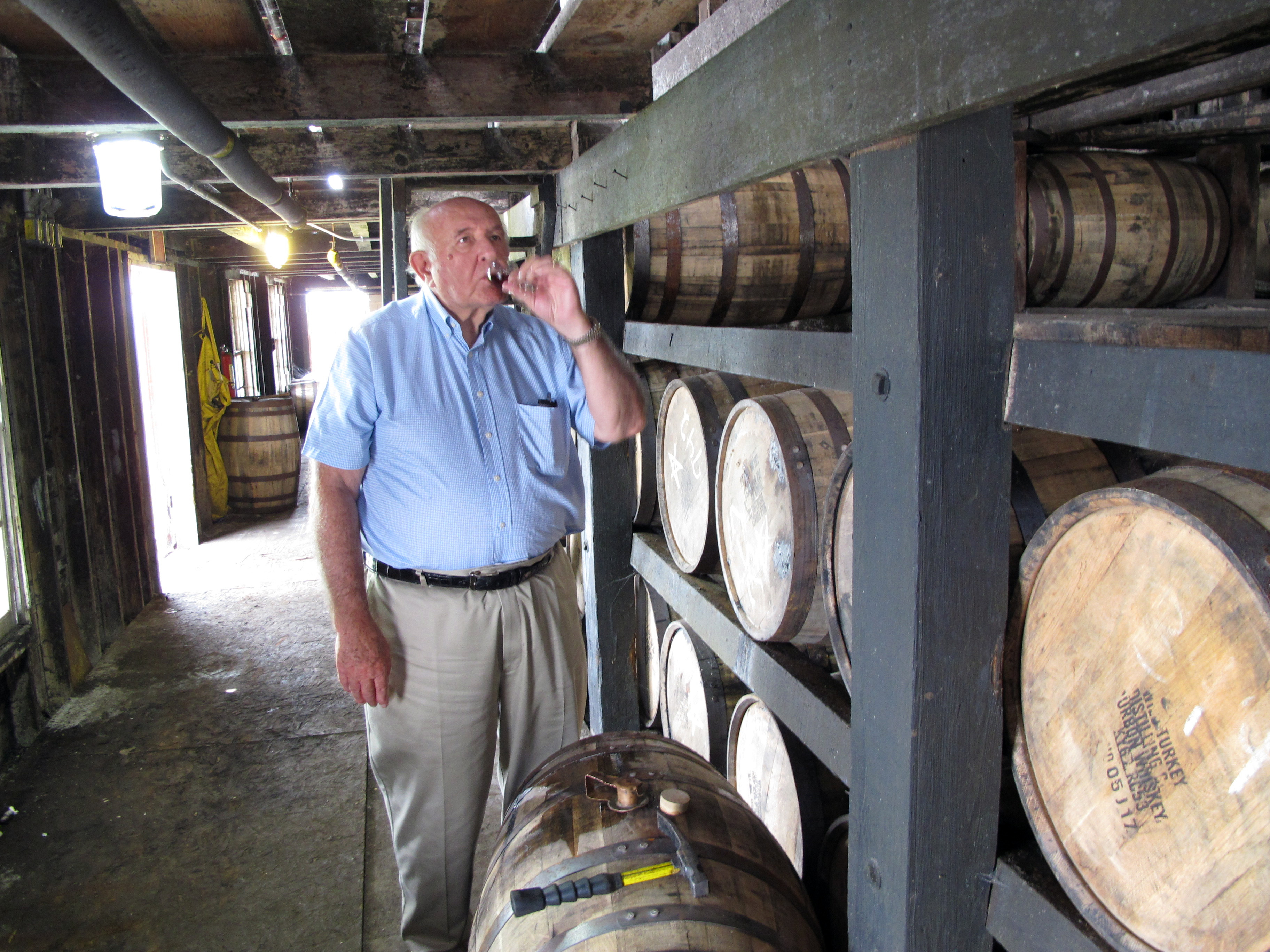Wild Turkey master distiller Jimmy Russell takes a sip of bourbon drawn from the barrel at a warehouse near Lawrenceburg, Ky. on Aug. 22, 2014.
