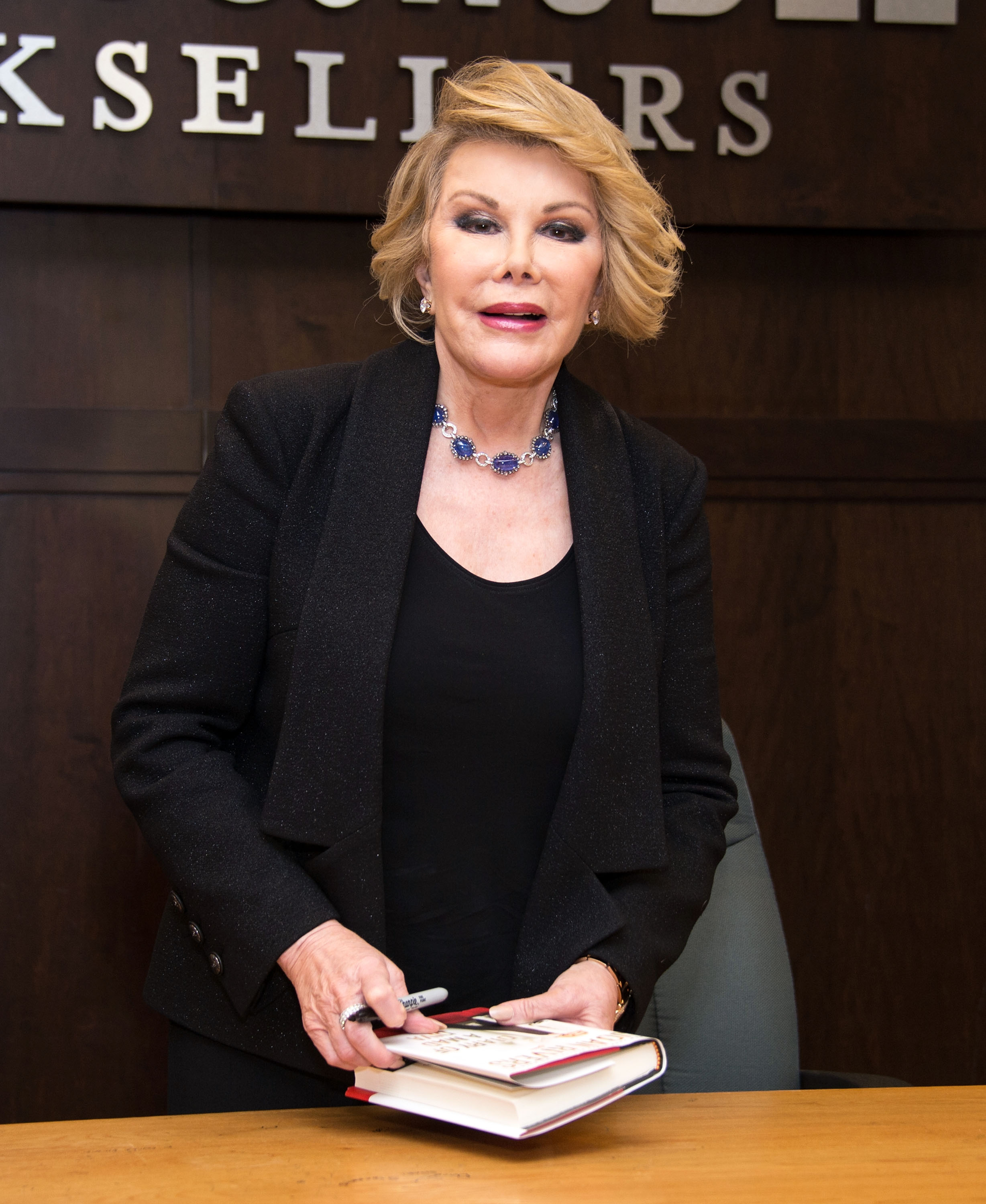 Comedian Joan Rivers poses before signing copies of her new book  Diary Of A Mad Diva  at Barnes & Noble bookstore at The Grove on July 10, 2014 in Los Angeles, California.