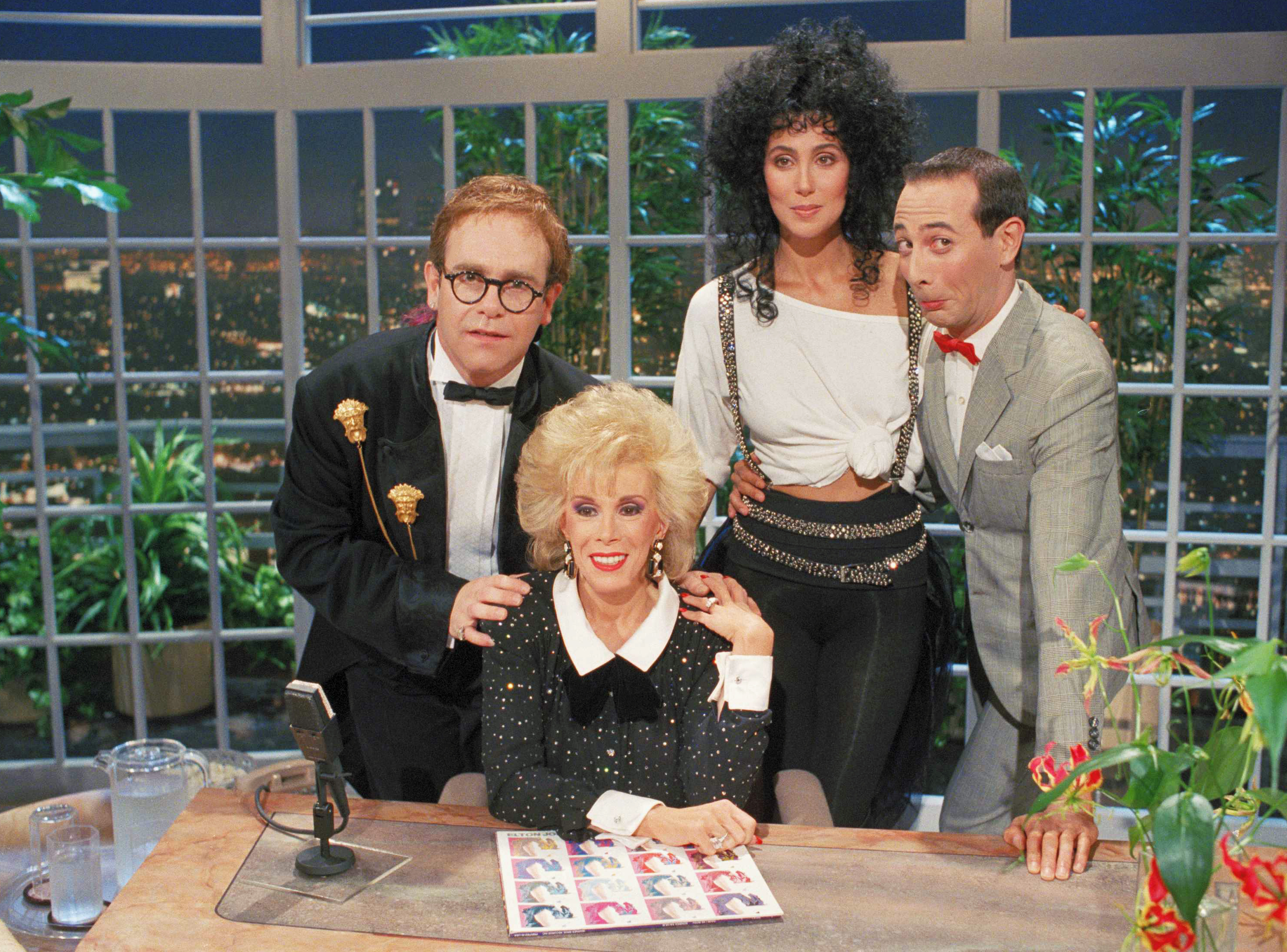 "By 1986, Rivers had been cut out of Carson's circle, having signed on to host ""The Late Show Starring Joan Rivers"" on Fox. Elton John, Cher and Pee Wee Herman joined Rivers for her first episode."