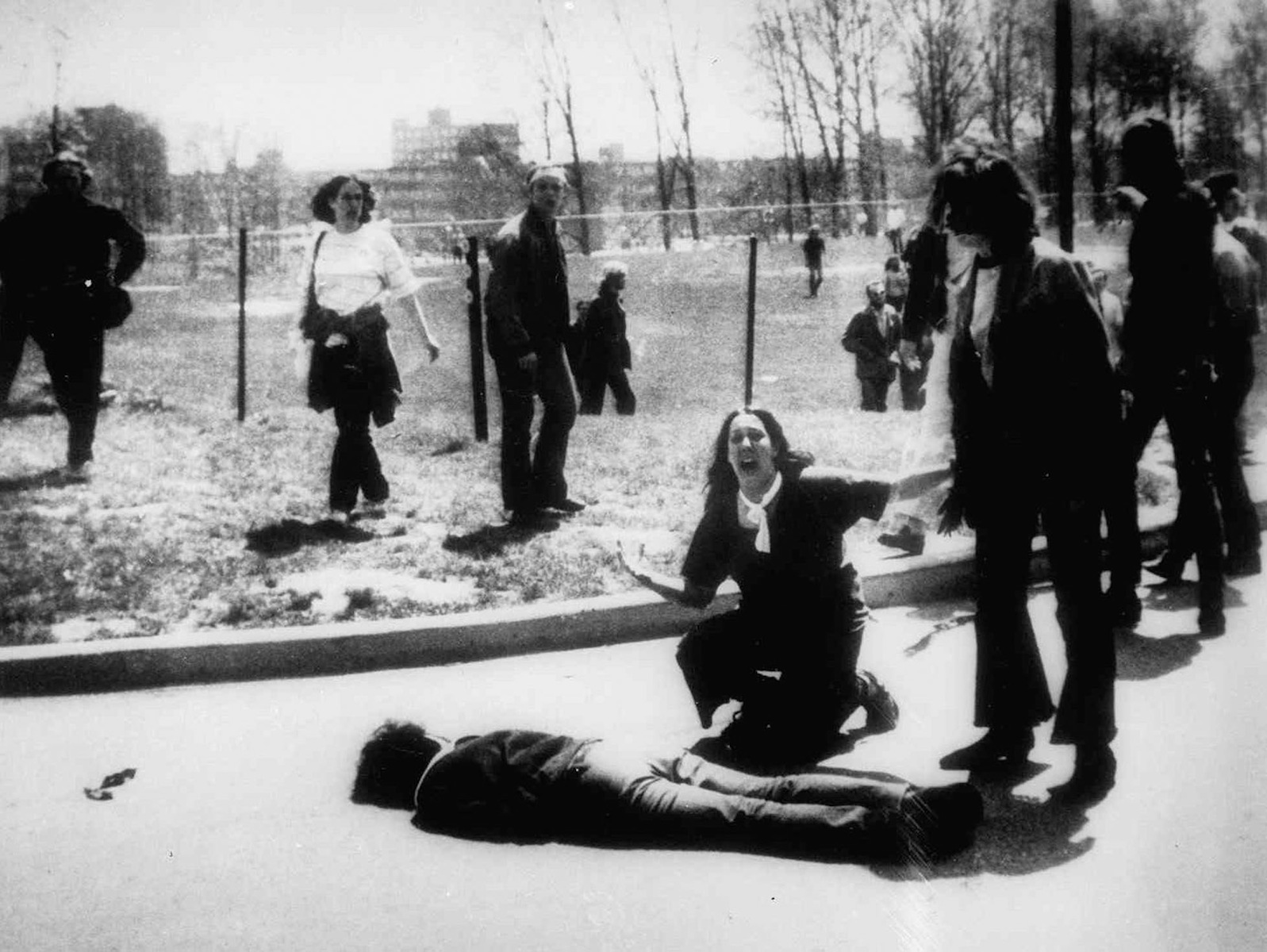 Mary Ann Vecchio kneels by the body of a student lying face down on the campus of Kent State University, Kent, Ohio on May 4, 1970.