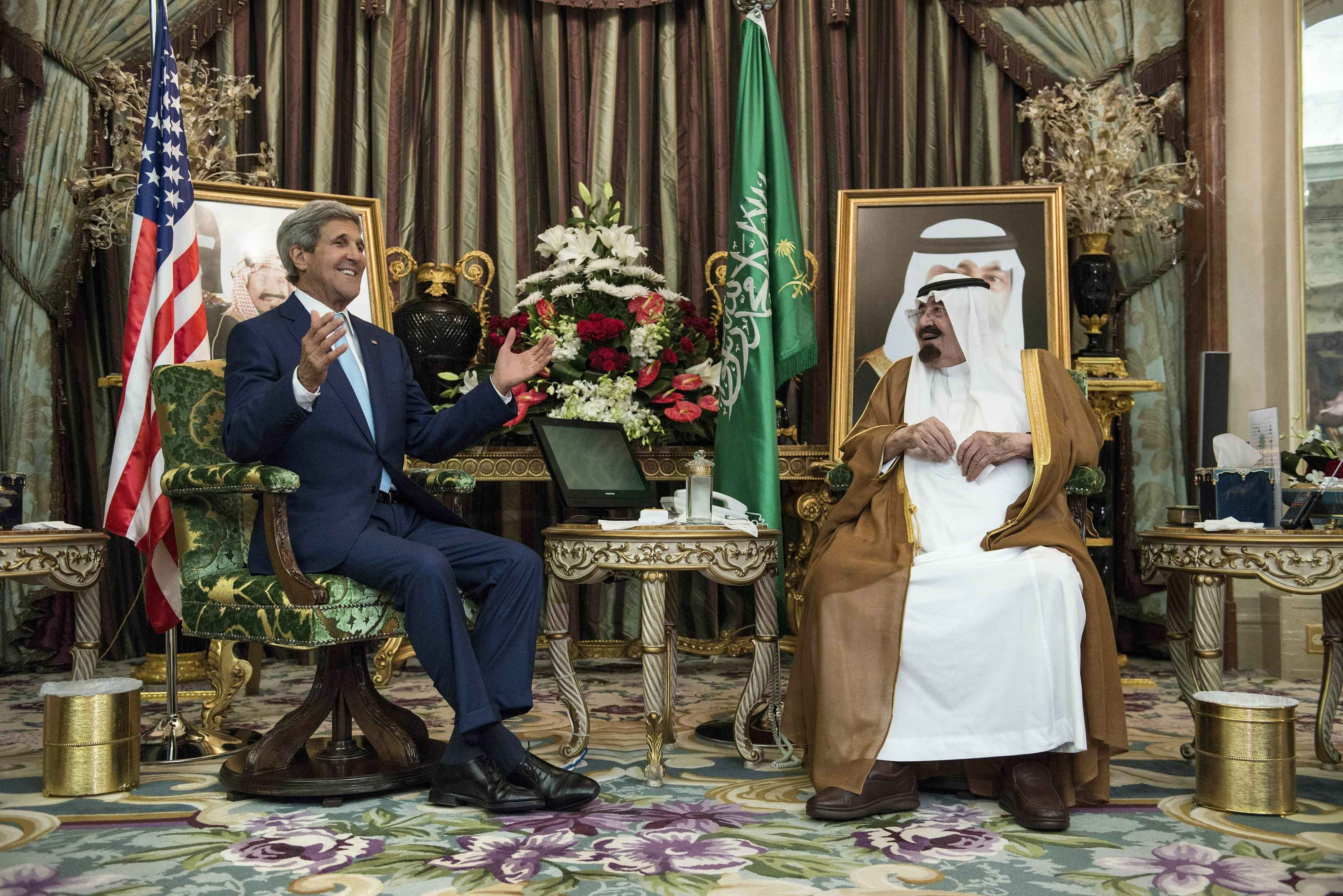 Saudi King Abdullah listens to U.S. Secretary of State John Kerry before a meeting at the royal palace in Jeddah, Saudi Arabia,  on Sept. 11, 2014