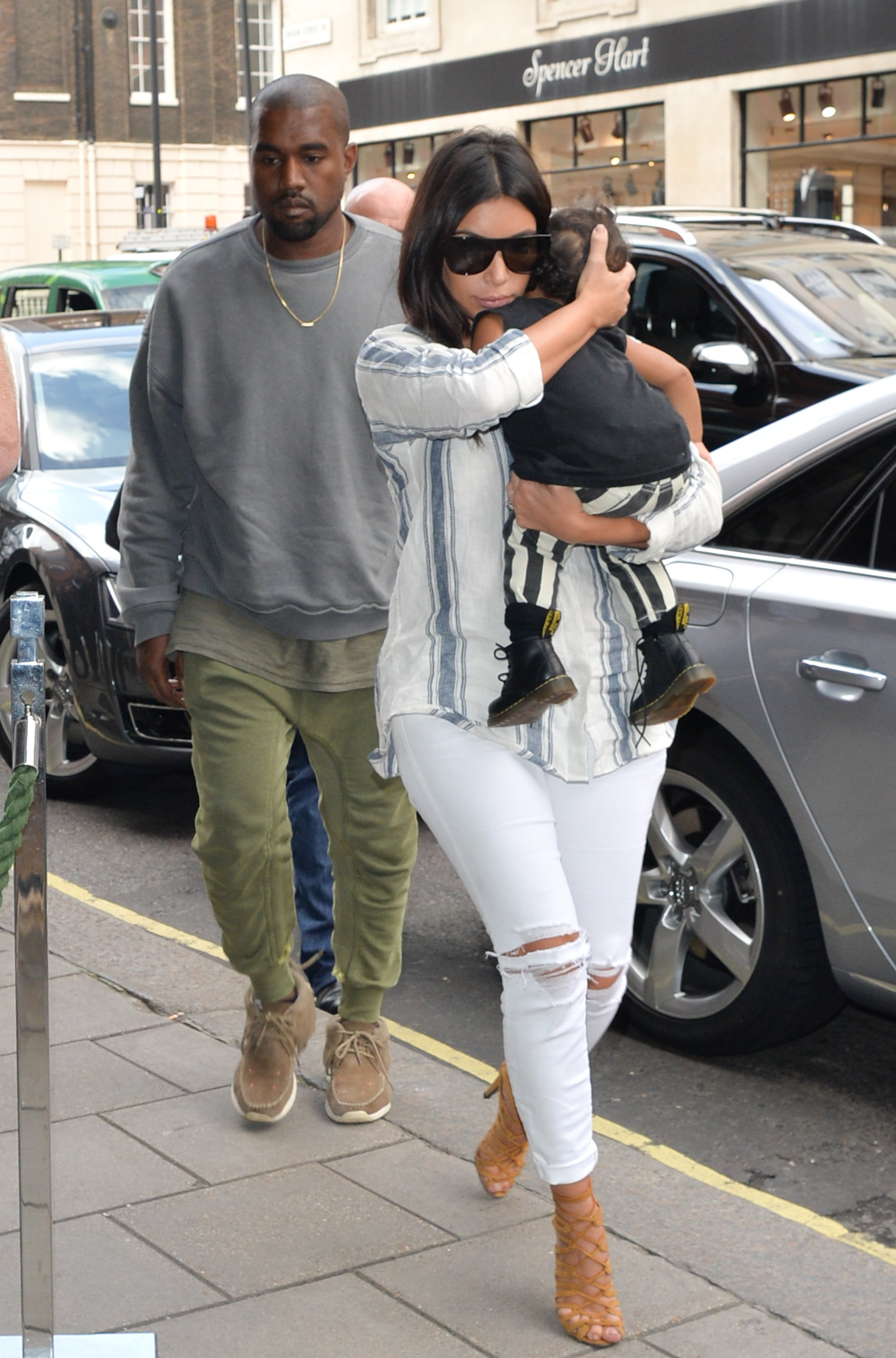 Kim Kardashian and Kanye West seen arriving at their hotel with their daughter North West on September 2, 2014 in London.