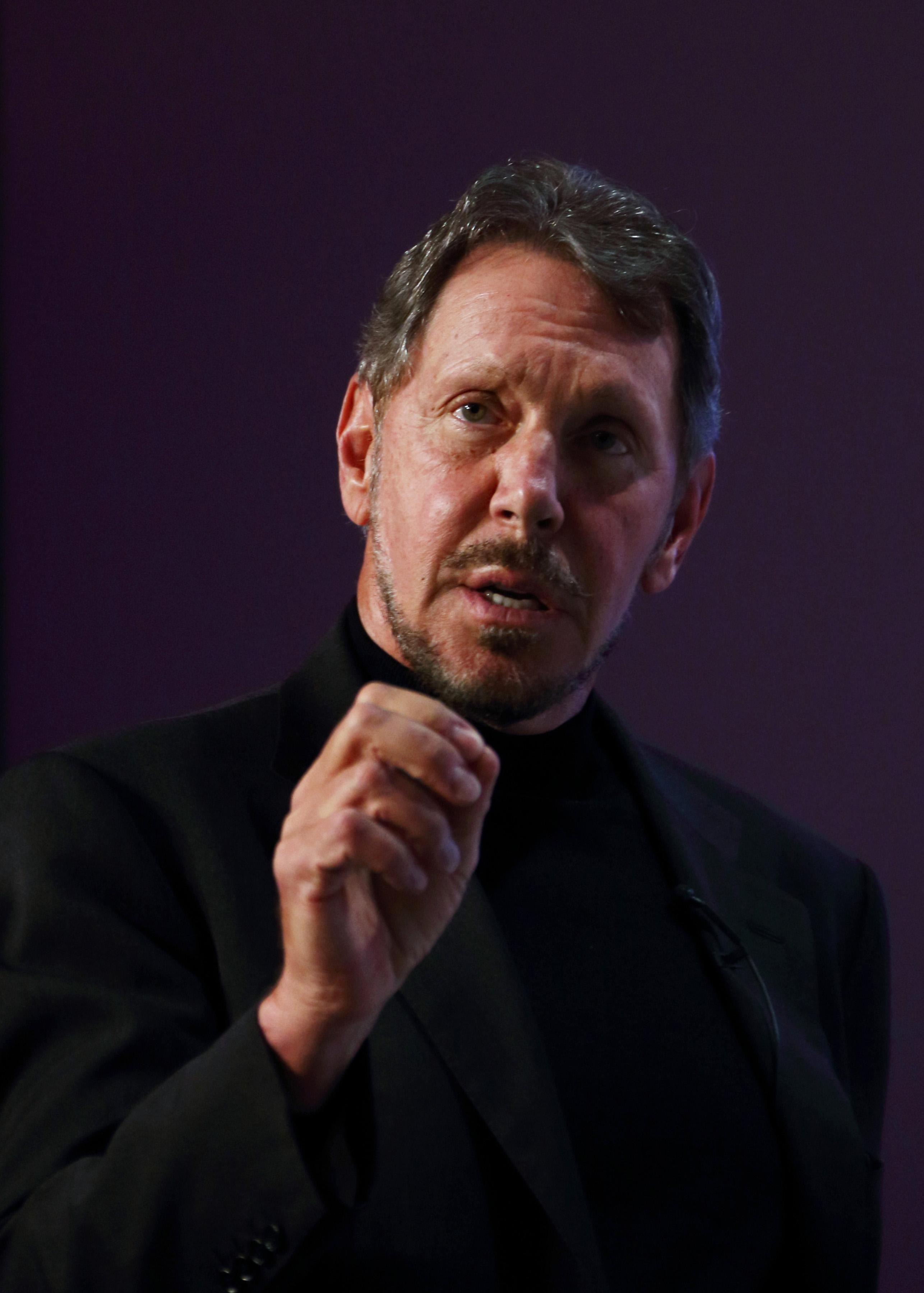 Larry Ellison, chief executive officer of Oracle Corp., makes a speech at the New Economy Summit 2014 in Tokyo on April 9, 2014.